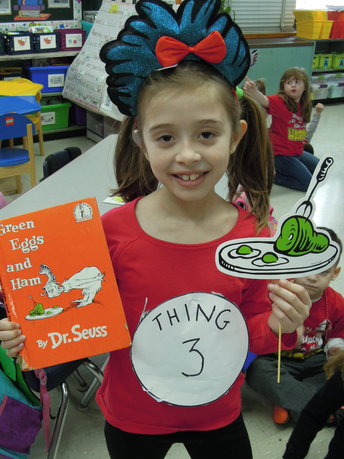 "Seaford third-grader Madison Marin displayed her ""Thing 3"" badge after reading one of her favorite Dr. Seuss books to kindergartners."