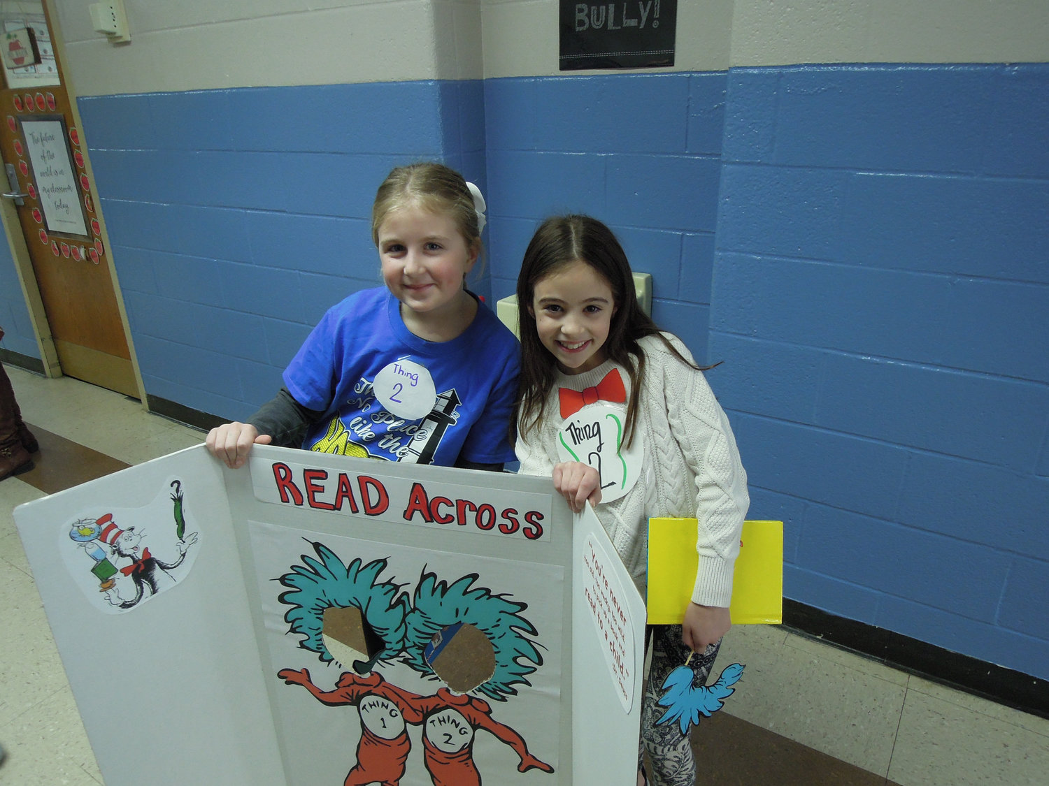 Seaford readers Jillian Mooney, left, and Giuliana Viggiano displayed their sign promoting Read Across America Day on March 1.