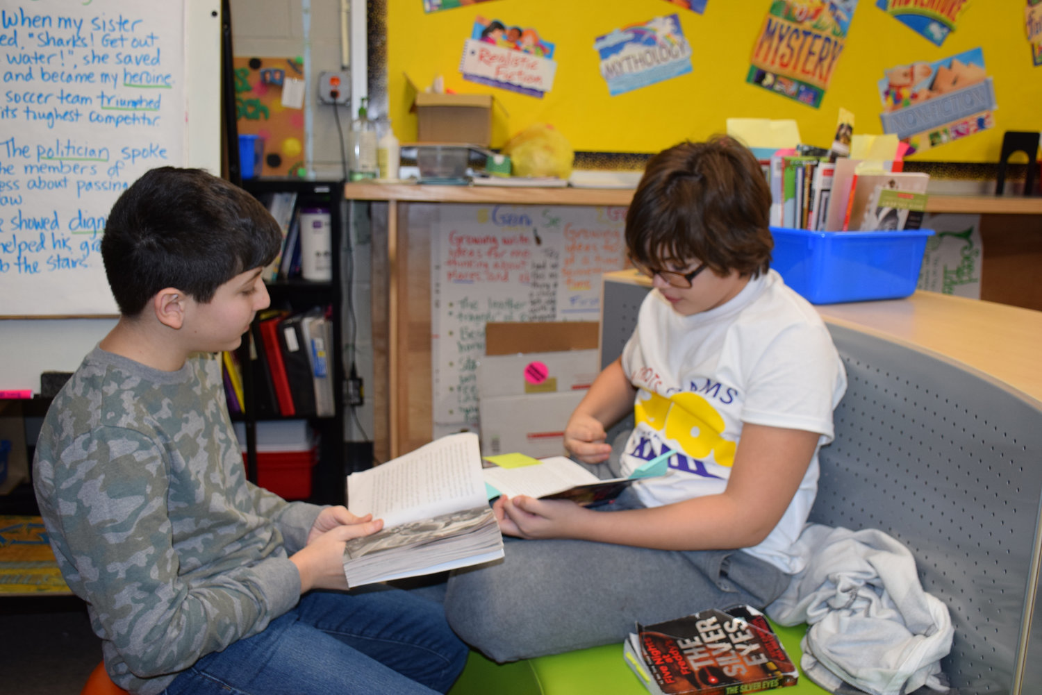 Wantagh Middle School students Anthony Marullo, left, and Nicholas Brown read aloud to each other.