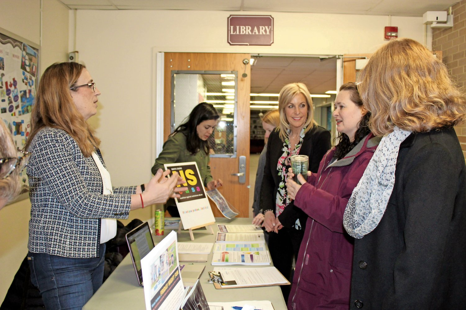 "Alison Camardella, president of the North Shore Coalition Against Substance Abuse, greeted parents as they arrived for the organization's ""Parent University"" event on Monday."