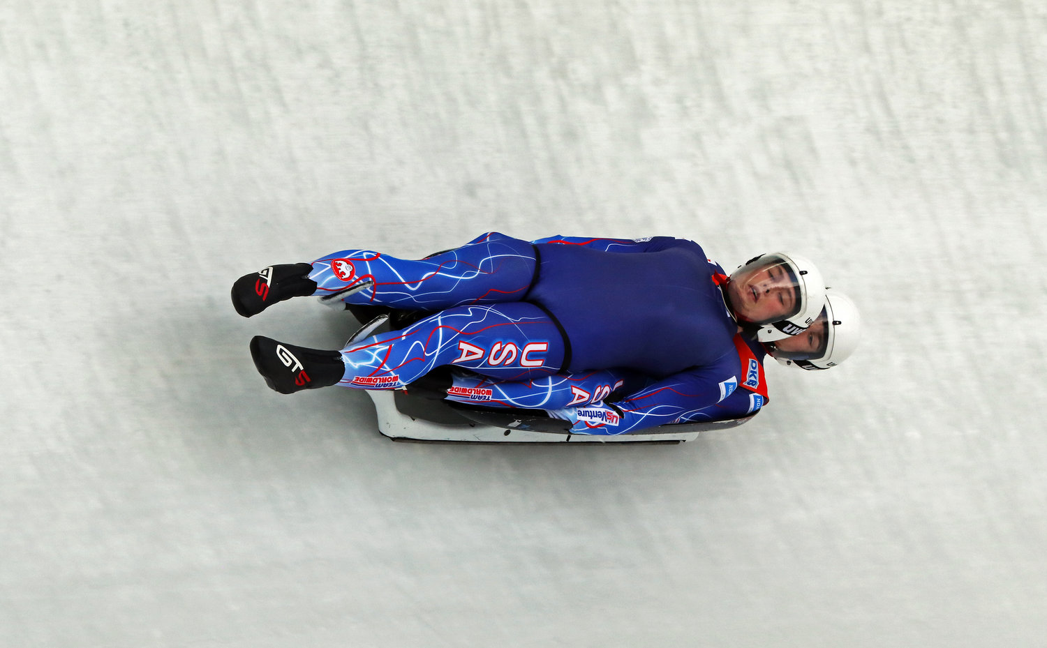 Luge slider Sam Day, on top, and his doubles partner, Michael O'Gara, speeding down a luge run in Igls, Austria, near Innsbruck. Sleds can reach speeds of 85 mph.