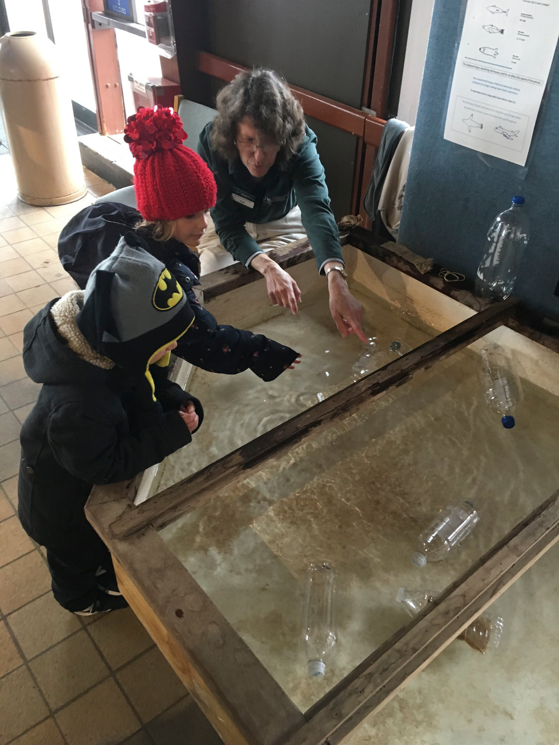 Five-year-old Isla Lomitola and her brother, 3-year-old Dylan, learned about different mammals' skin and fur, and how the animals move through water, from nature center Environmental Educator Pam Hunter.