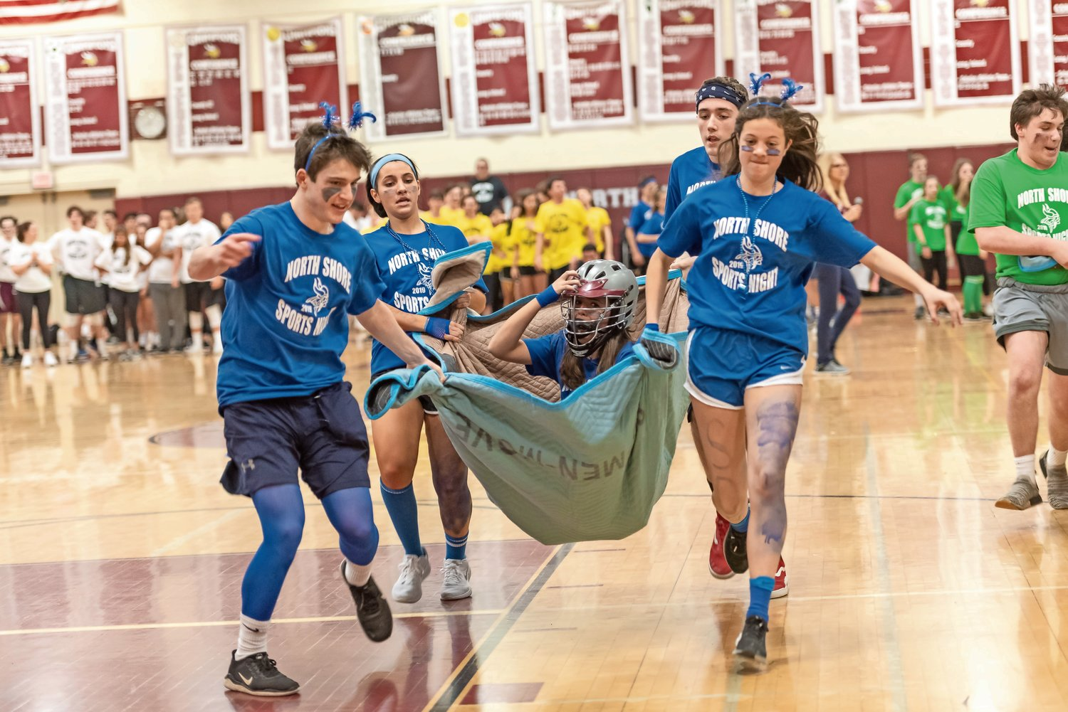 Members of the sophomore class carried one of their peers in a blanket during one of the many relay races.