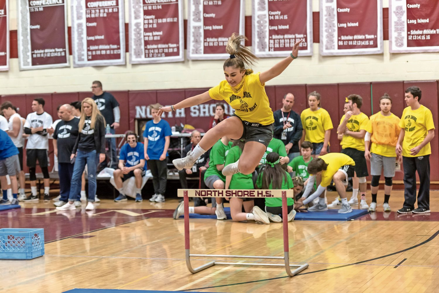 Junior Gabby Scott leaped over a hurdle in the obstacle course.