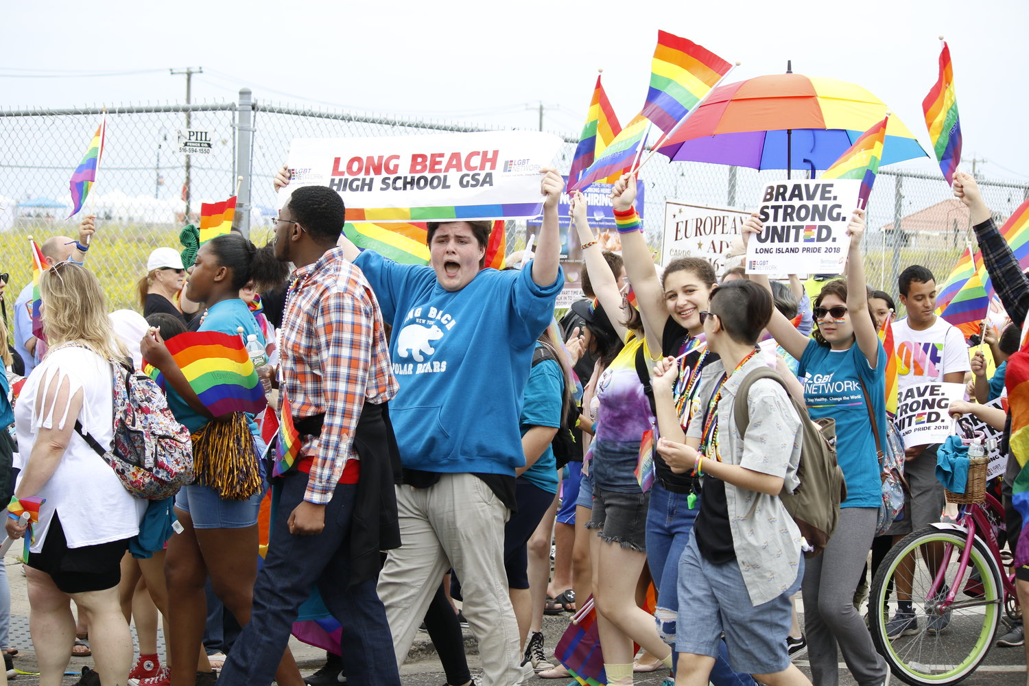 Joseph Carrasco, in blue, a Long Beach High School student and a member of the school's Gay Straight Alliance, was among the thousands who marched in last year's Pride on the Beach parade.