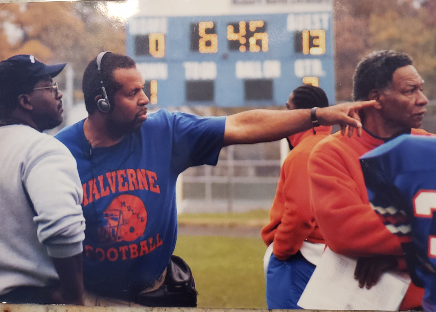 James, left, and assistant coaches Fred Brewington and Charlie Nanton led Malverne's 1990 team to an undefeated season.