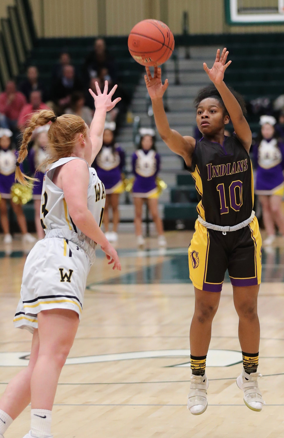Flo Hunte, right, hit some clutch shots in the second half to help the Lady Indians rally for their first-ever county crown.