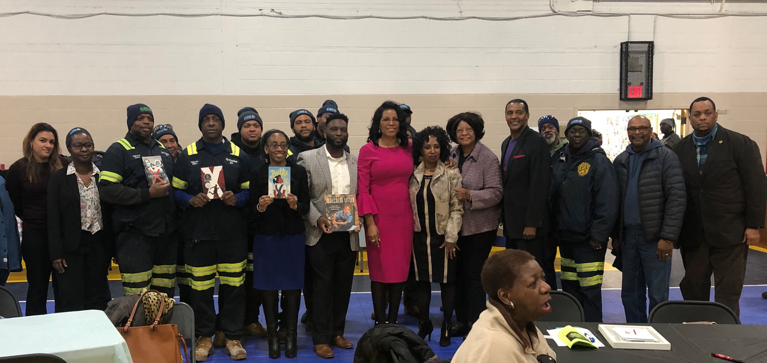 About 50 people turned out to hear from Ilyasah Shabazz, center, the daughter of civil rights activist Malcolm X, including members of the city's Civil Service Employees Association and students from Hempstead High School at Long Beach's MLK Center. The event was hosted by Councilwoman Anissa Moore and MLK Center Chairman James Hodge.