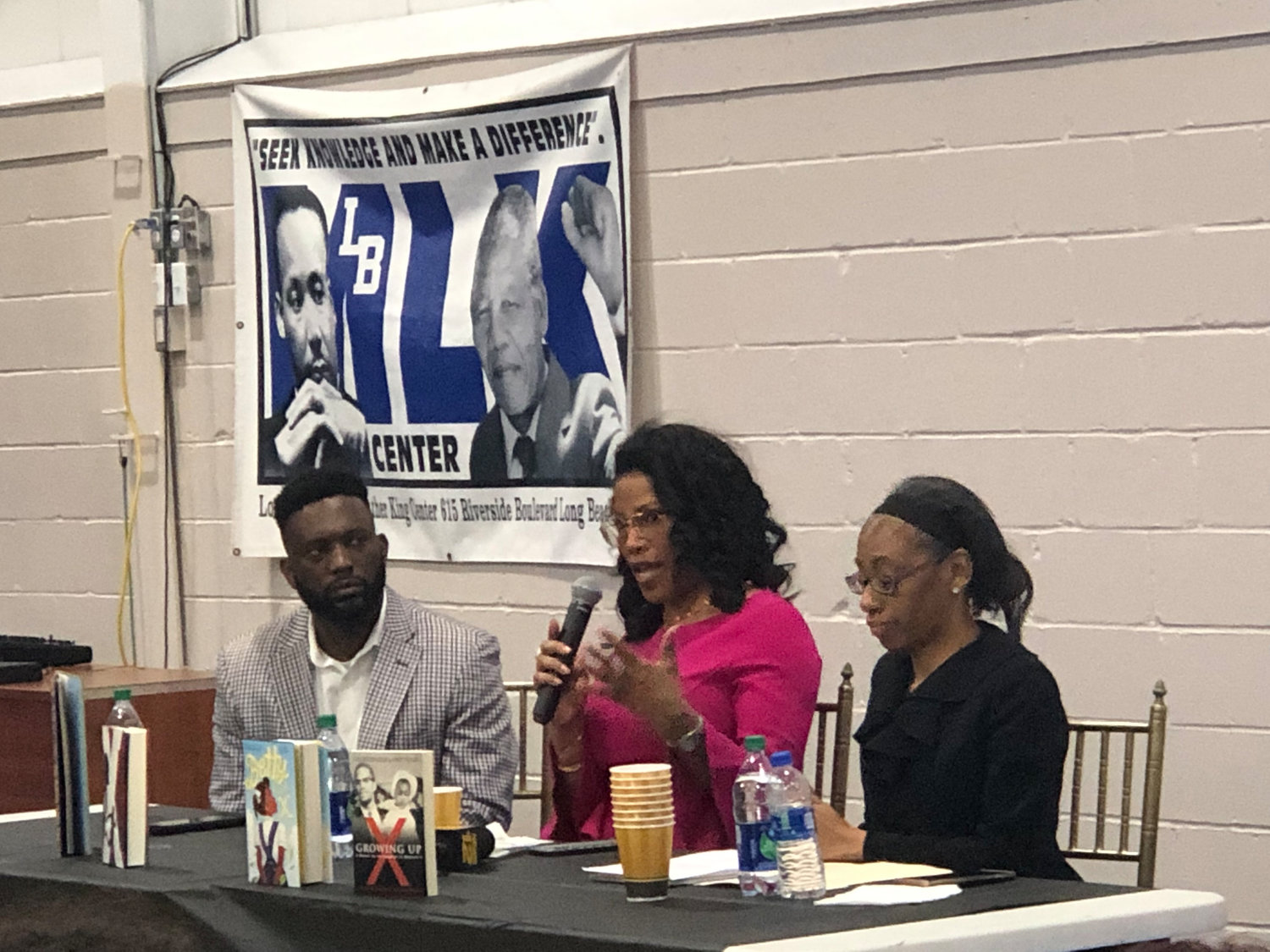 The event was hosted and moderated by MLK Center Chairman James Hodge, left, and City Councilwoman Anissa Moore, right.