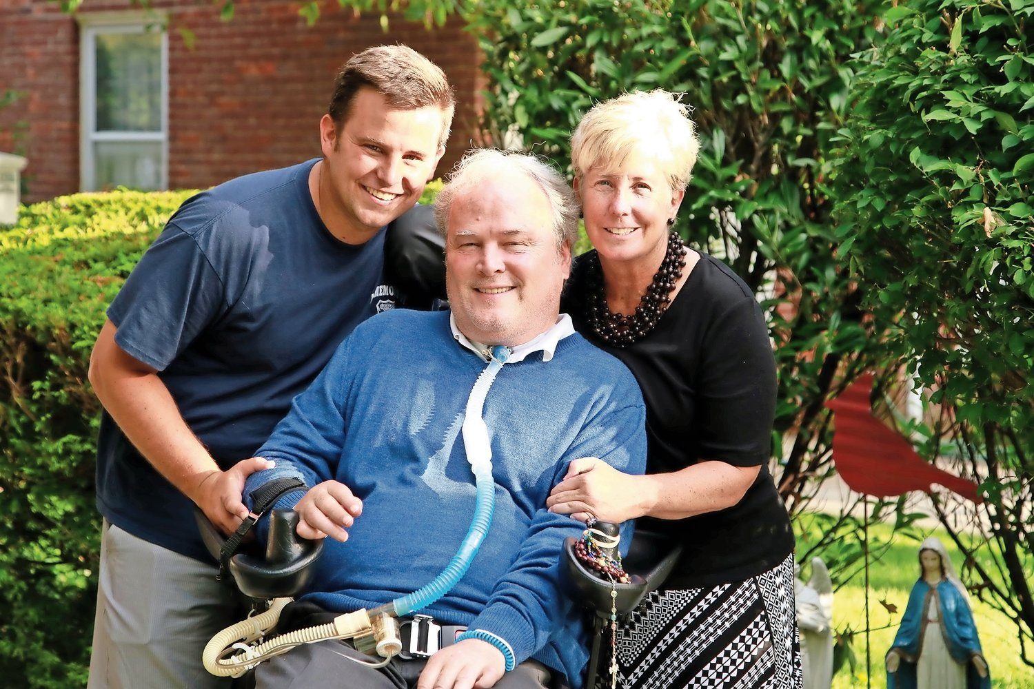 NYPD Detective Steven McDonald, center, with his wife, Patti, and their son, NYPD Sgt. Conor McDonald.