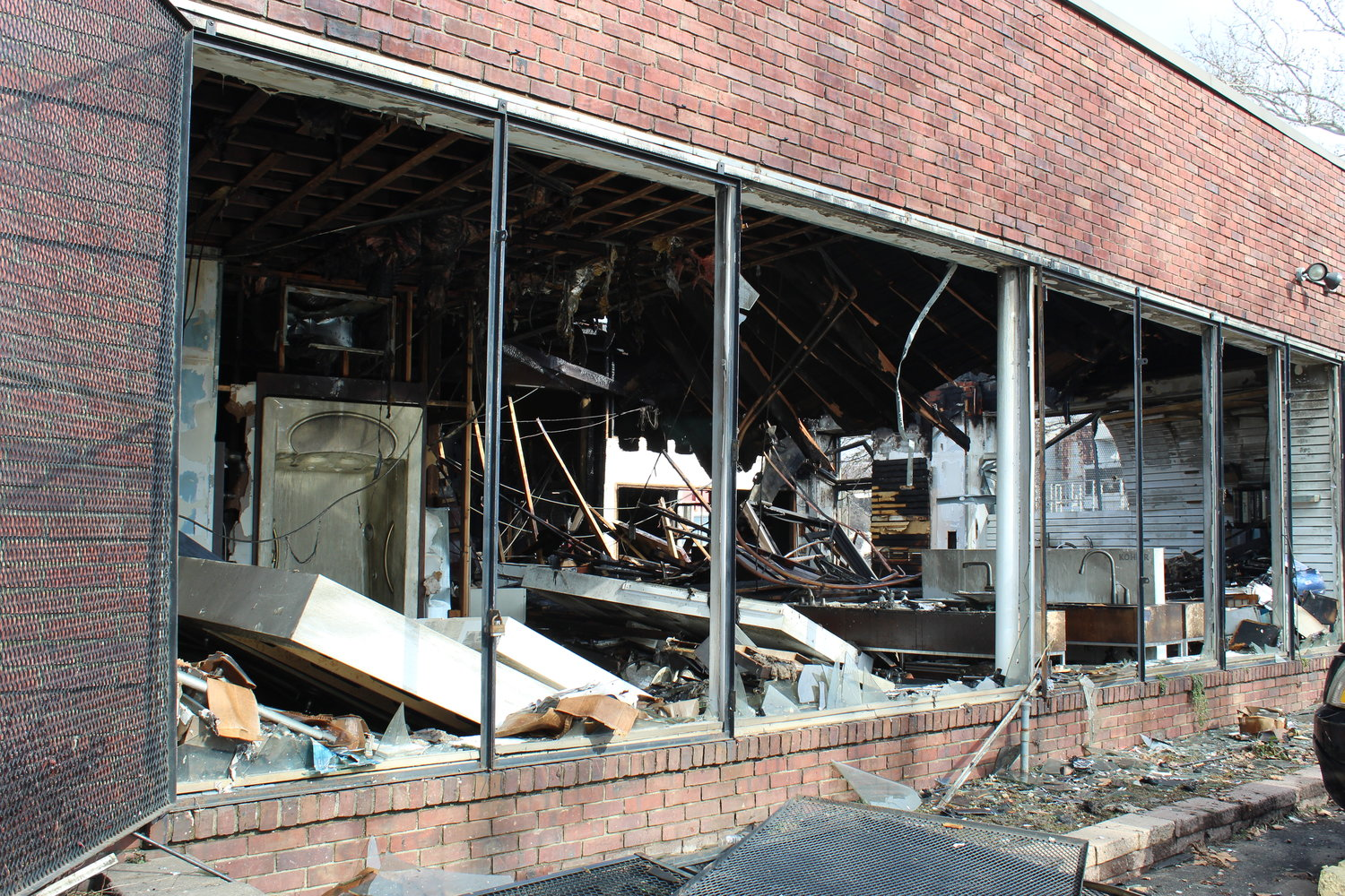 The blaze caused parts of the ceiling to buckle and blew out most of the store's windows.