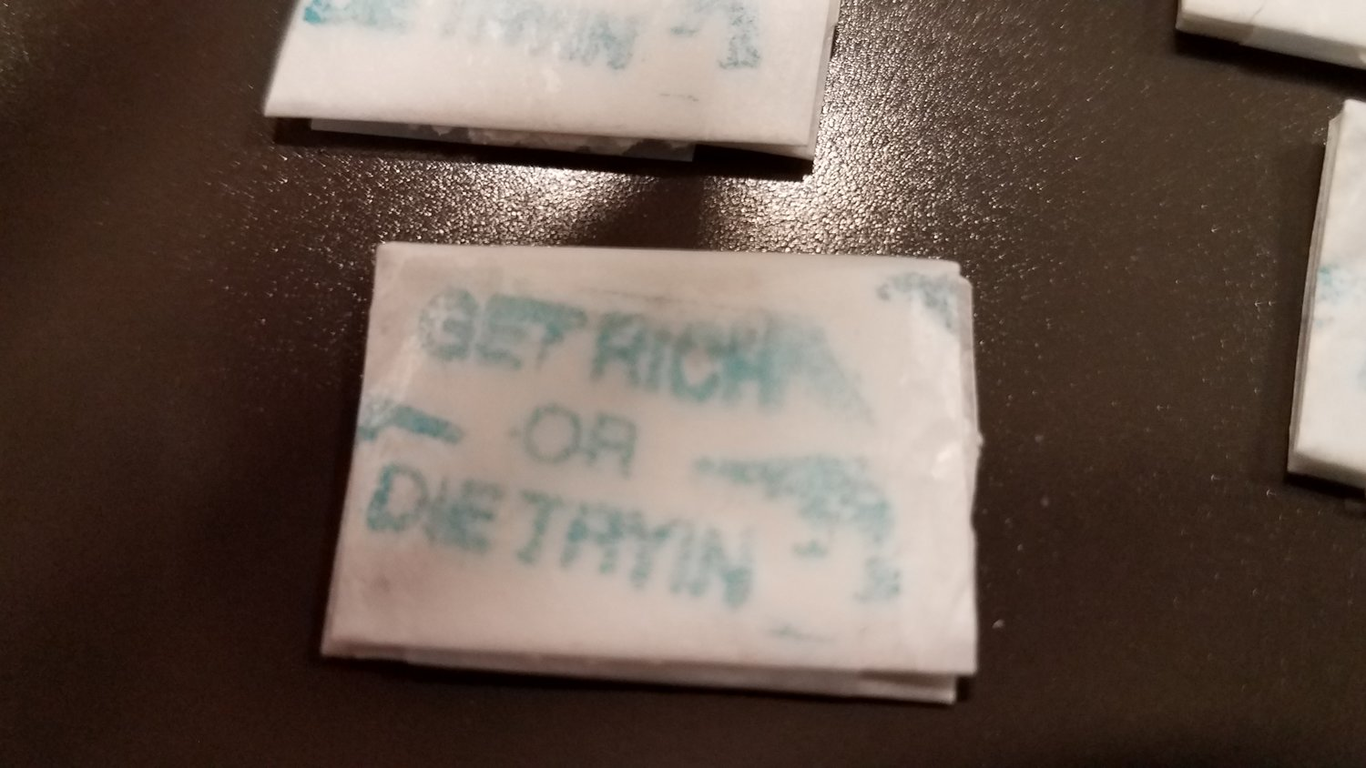 "Police found 27 white glassine envelopes stamped with ""Get Rich or Die Tryin,"" believed to contain heroine and crack cocaine at a home in Lakeview on March 8."