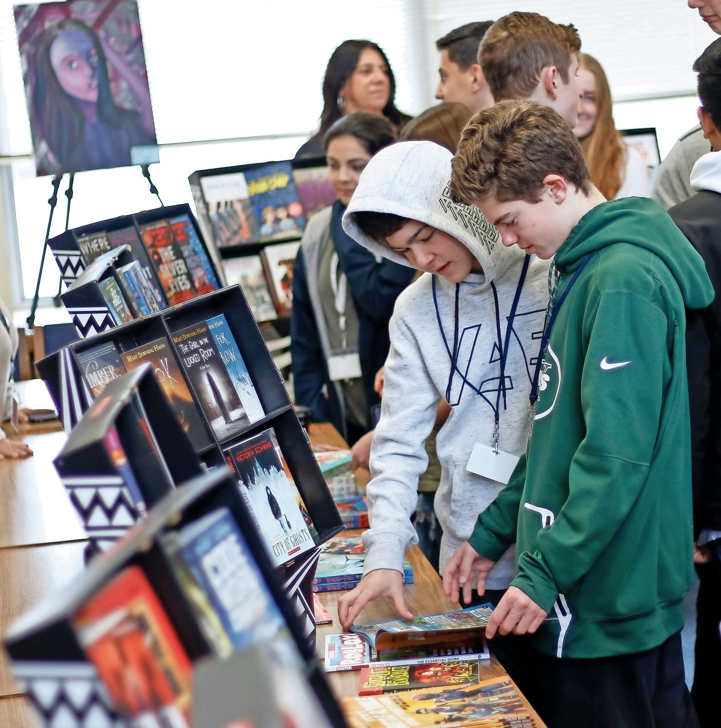 "The gaming books were a big hit with the students, some looking for help beating tougher levels in the videogames. Matt Jerchower and Trevor Rinn, who are ninth-graders, flipped through a book with tips and tricks for ""Fortnight Battle Royale."""