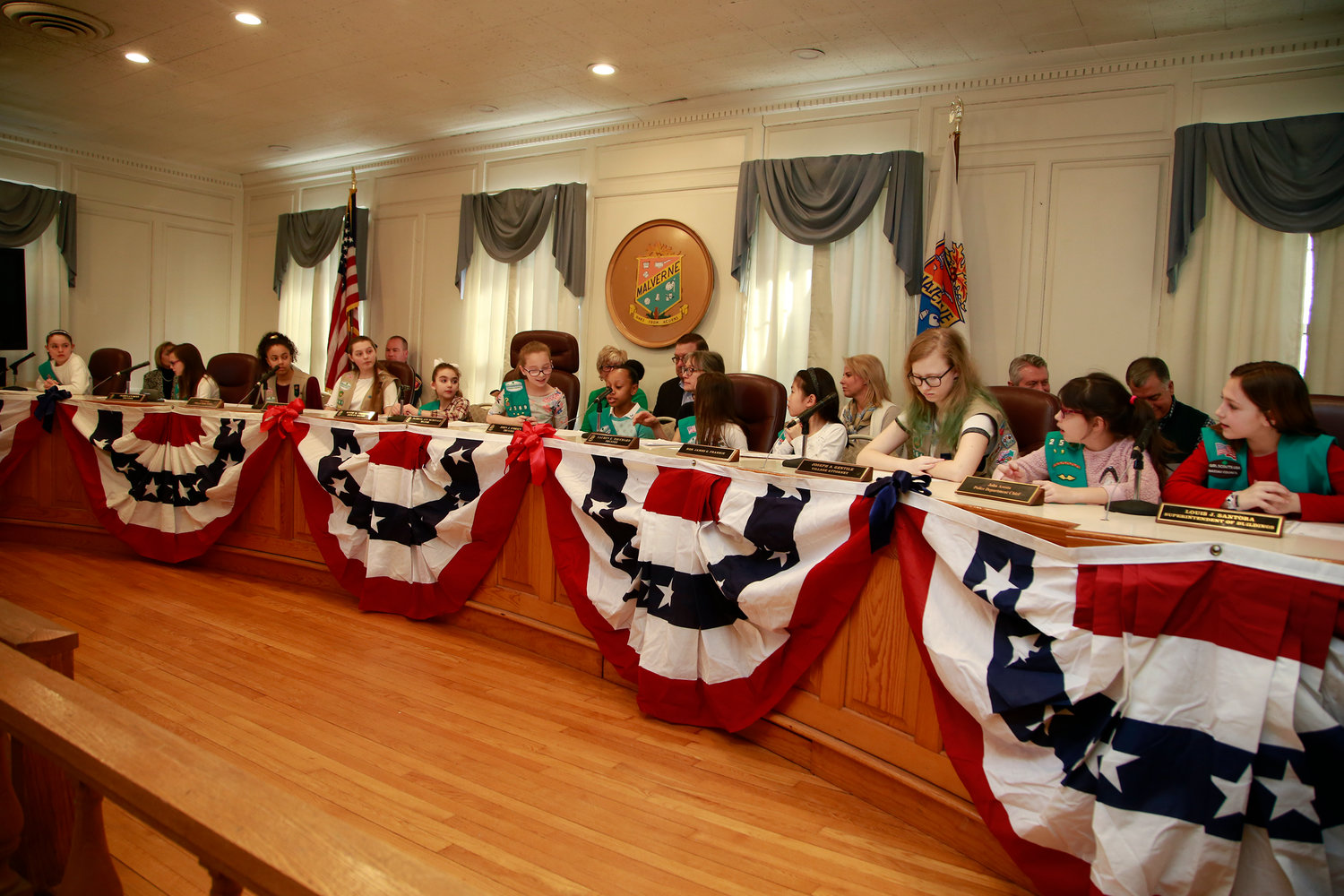 Local Girl Scouts filled in for members of the village board during Girls Scouts Government Day last Saturday.