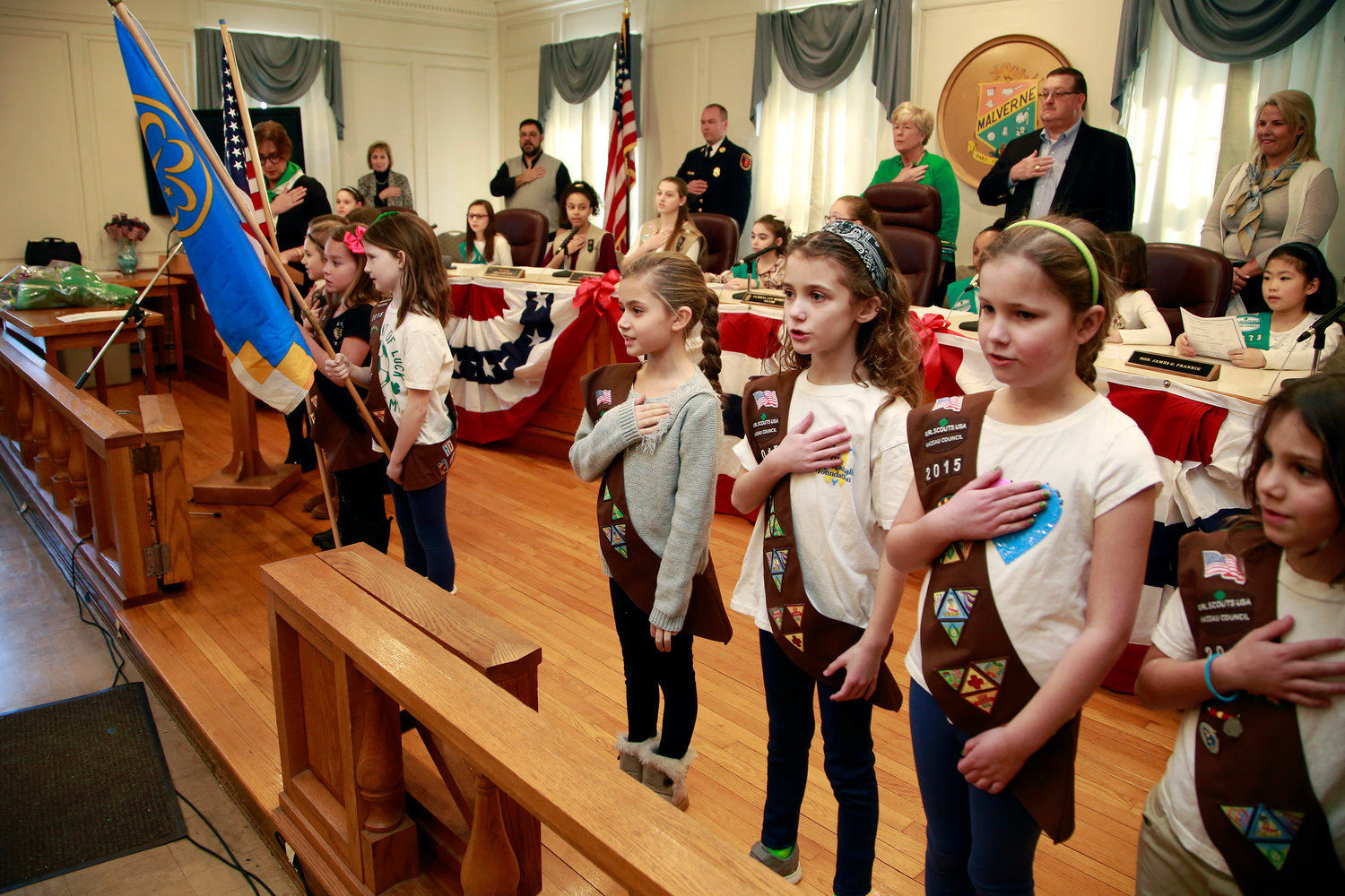Members of Brownie Troop 2015 in Malverne, taking part in Girl Scouts Government Day on March 9, recited the Pledge of Allegiance at Village Hall.