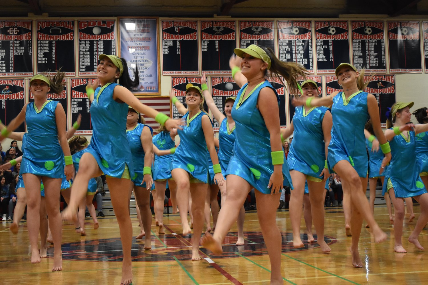 Blue dancers dressed as tennis players for one of their routines.