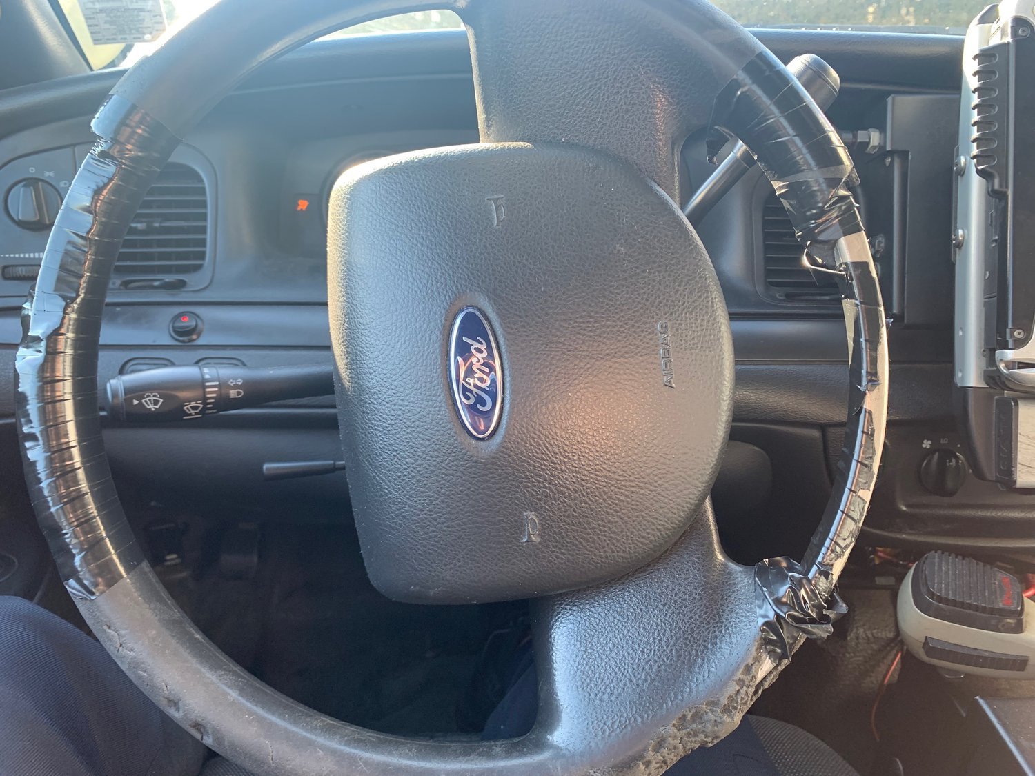 A deteriorated steering wheel had to be wrapped with electrical tape.
