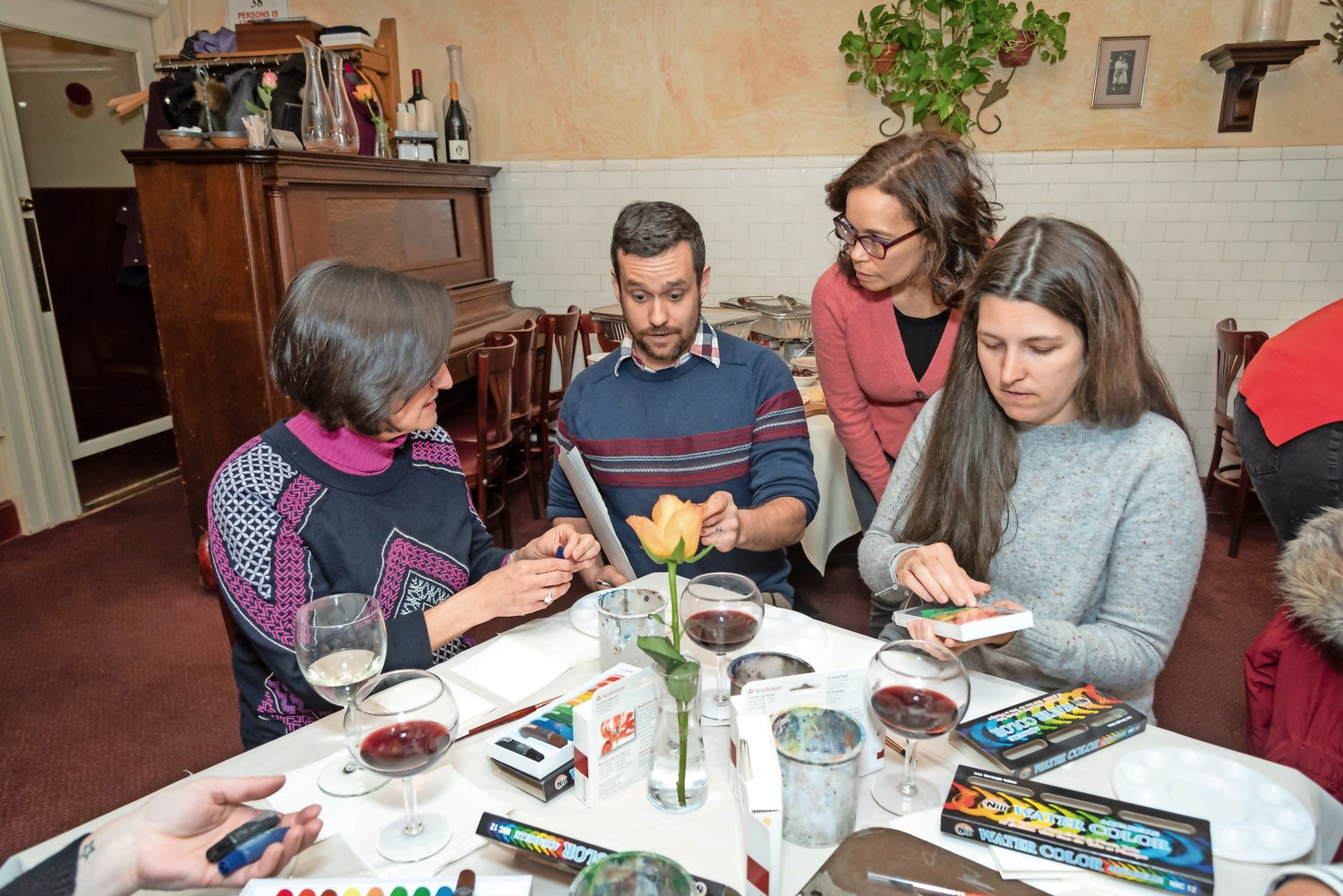 Alison Smith, left, Benjamin Benfield, Dalia Rodriguez and Kristie Leigh deliberated which paints they would use in their artworks.