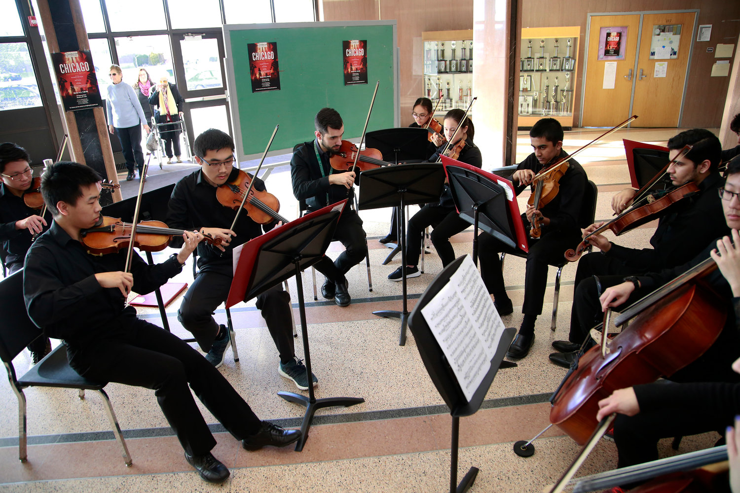 "The Clarke Camerata band, under the direction of Gregory Krajaci, played for guests before the W. T. Clarke High School acting troupe, Lights Up Productions, performed ""Chicago."""