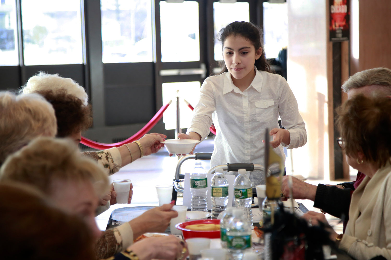Gabriela Ramirez, a seventh-grade student, volunteered by busing tables.