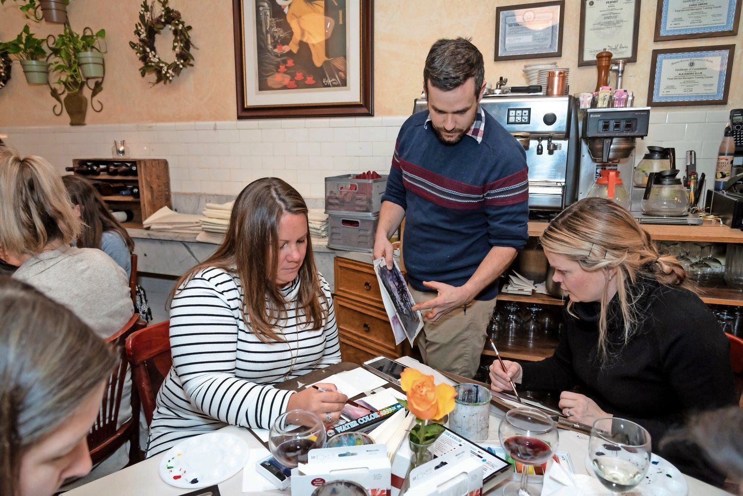 Vanessa Marks, left, and Jordan Loftus got an art lesson from NSMS art teacher Benjamin Benfield.
