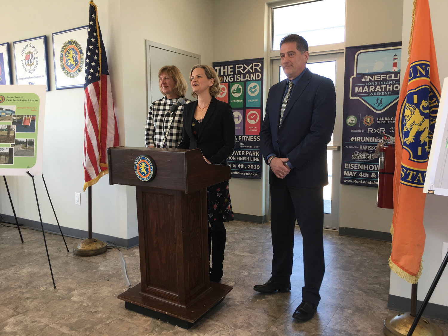County Executive Laura Curran, at lectern, was joined by Parks Commissioner Eillen Krieb and Deputy County Executive for Parks and Public Works Brian Schneider at a March 5 news conference focusing on the county's parks revitalization plan.