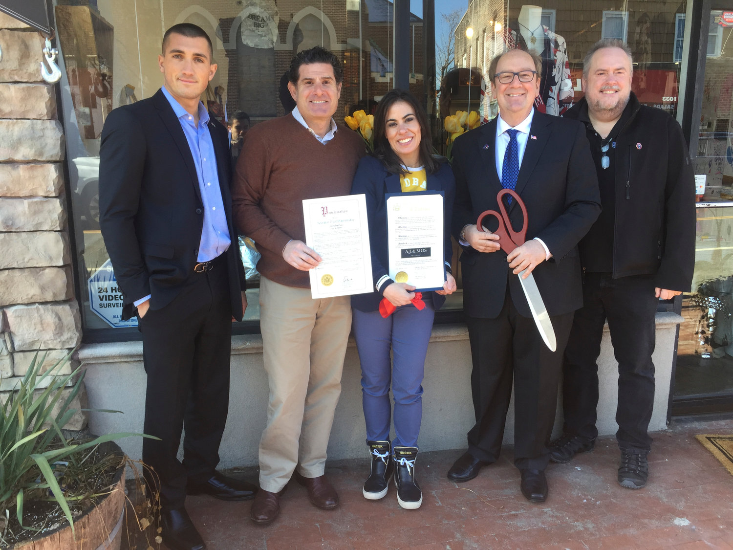 A.J. & MOS was welcomed with a ribbon-cutting on March 5. From left Joseph Bicocchi, the district manager for State Assemblywoman Melissa Miller, Gregg Star, Beth Star, Hewlett-Woodmere Business Association President David Friedman and HWBA First Vice President John Roblin.