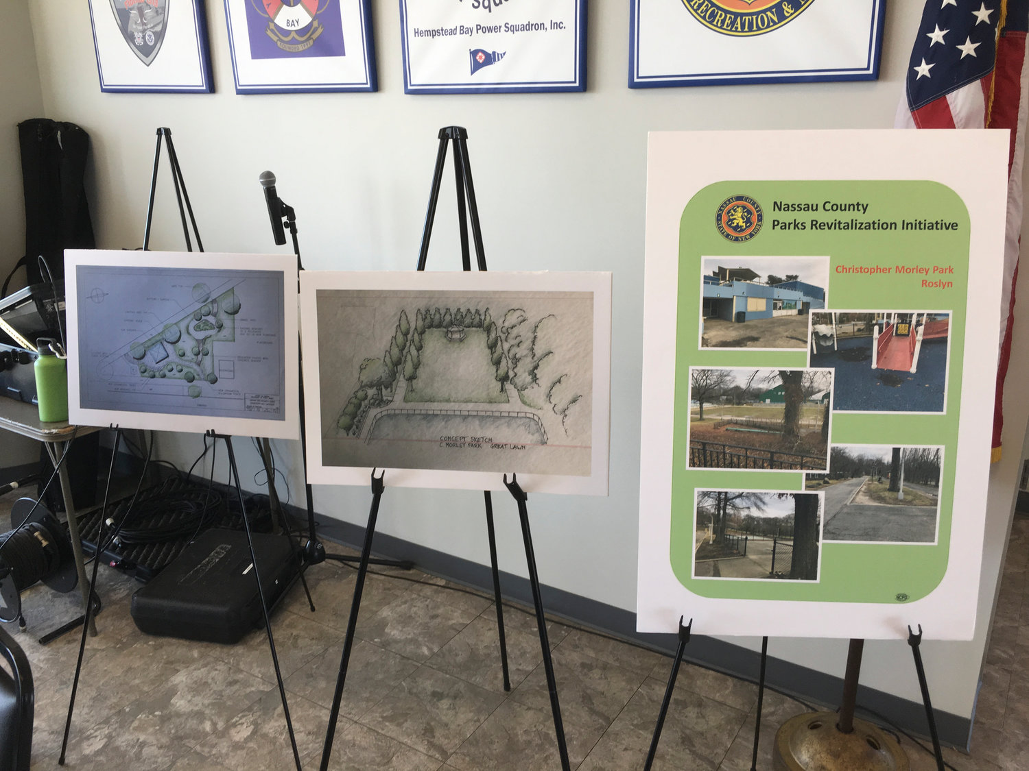 Posters depicting the Wantagh Park Butterfly Garden, left, and Christopher Morley Park Great Lawn conceptual revitalization plans, stood next to a poster of Christopher Morley Park pictures, right.