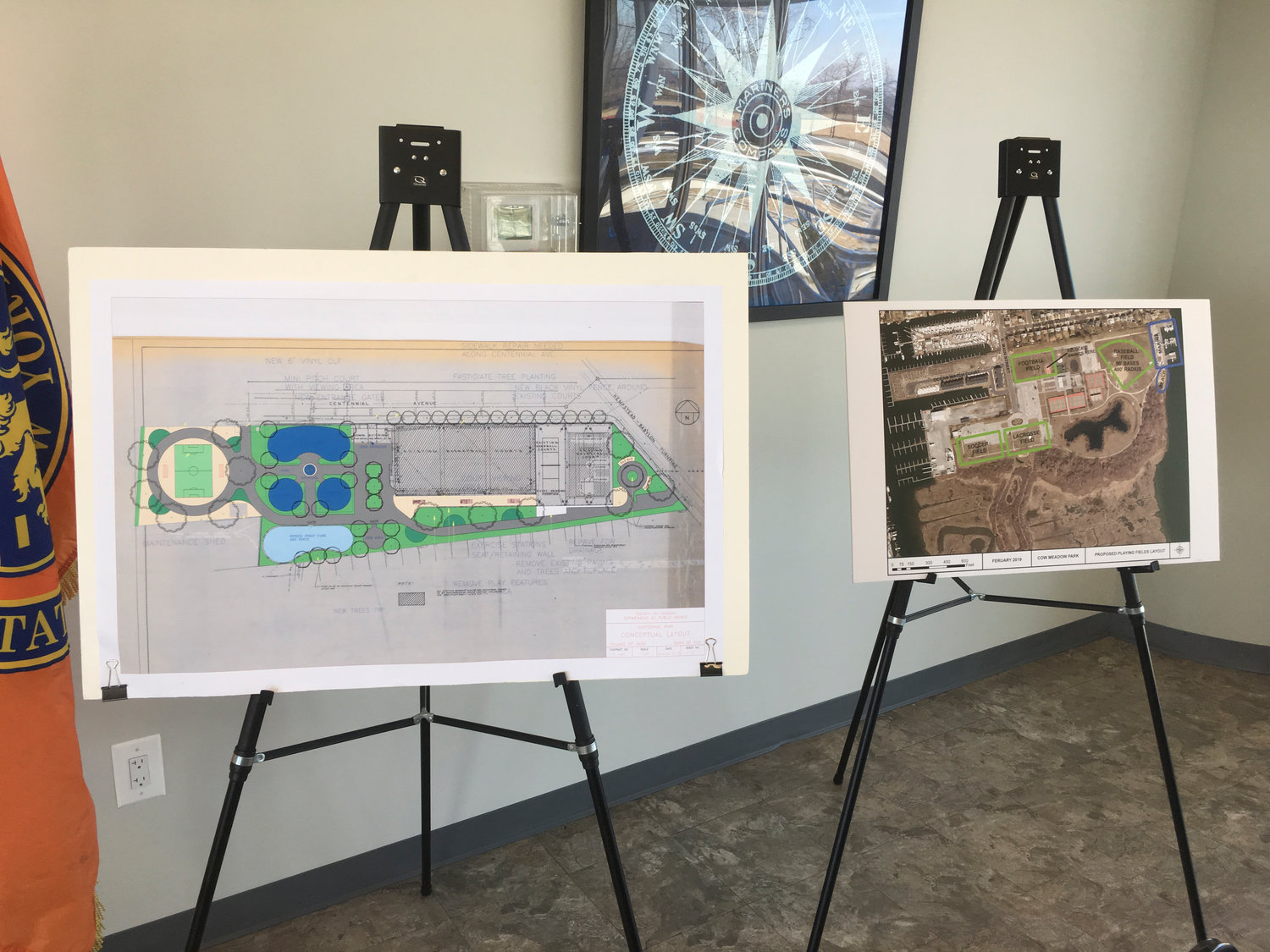 Posters depicting Centennial Park, left, and Cow Meadow Park conceptual revitalization plan were displayed in the front of the room at the Wantagh Park's Administration Building.