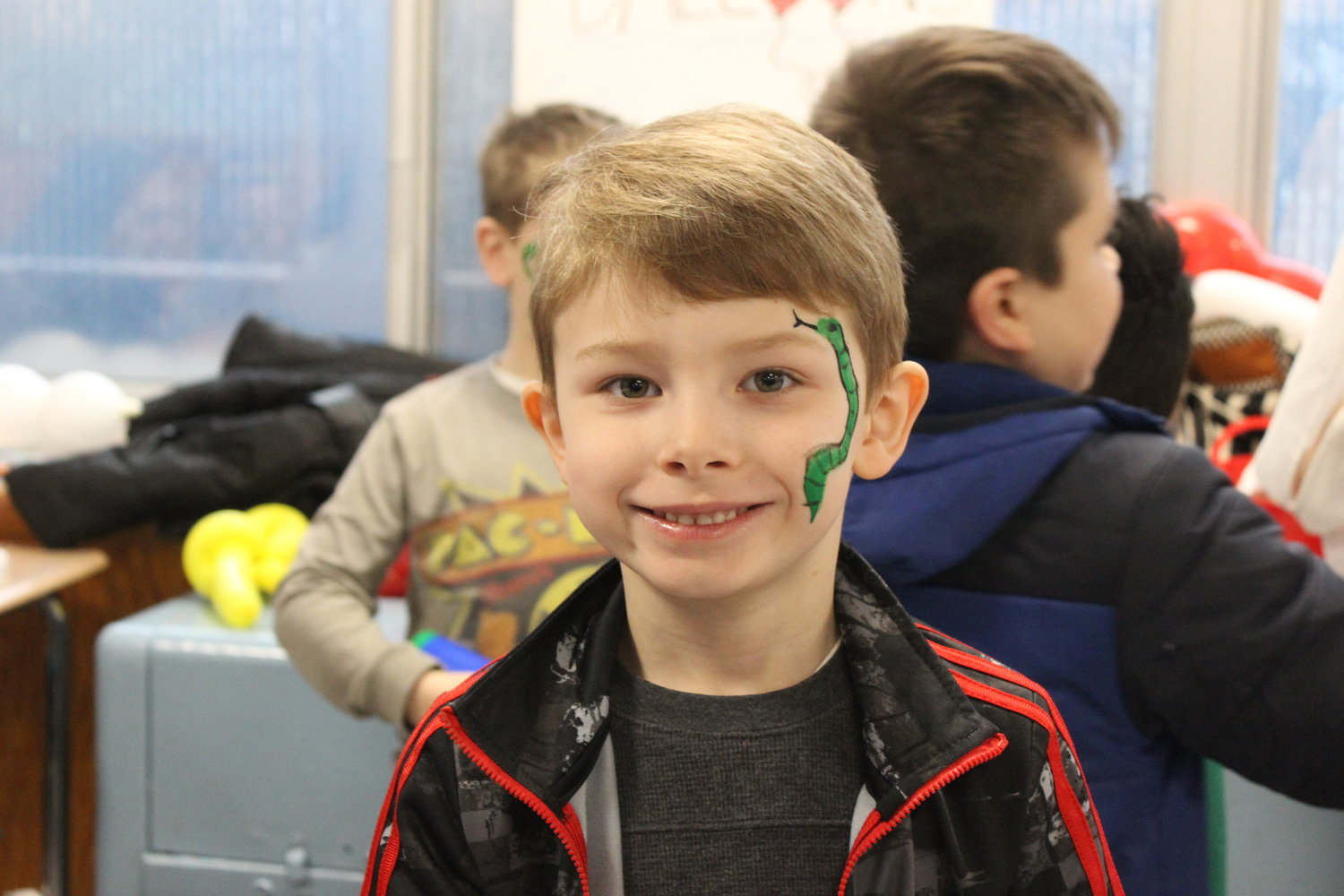 DeMarco Hernandez, 6, got his face painted and played with balloons at the event's kid's section.