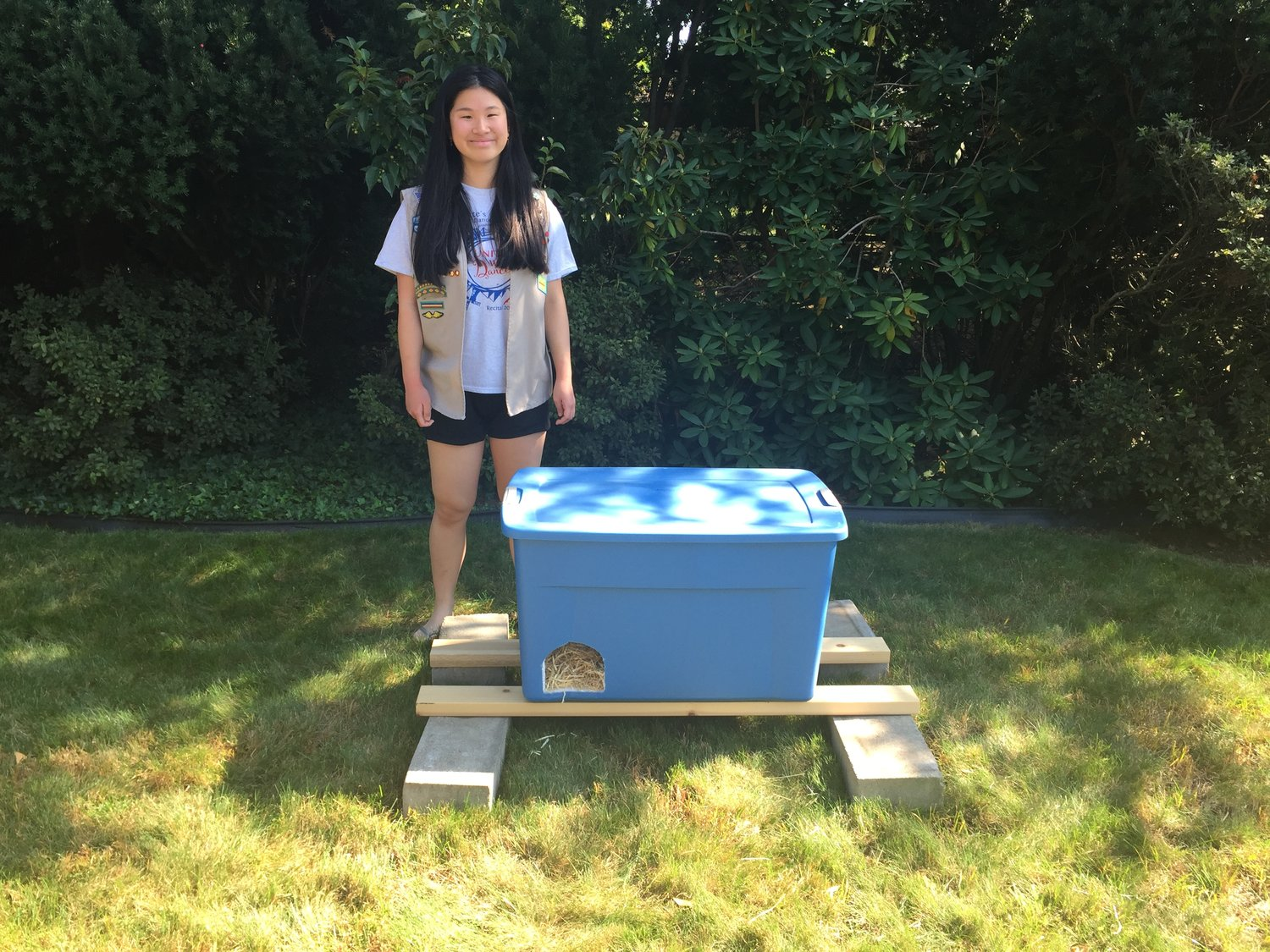 Eighteen-year-old Kayla Leone built six feral cat shelters out of plastic bins, wood and cinder blocks for her Girl Scout Gold Award project.