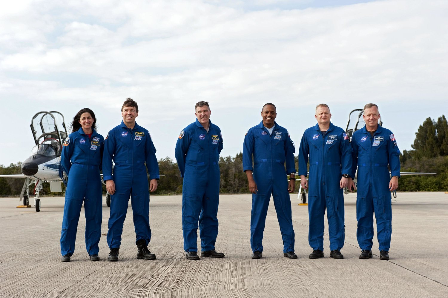 The crew of Discovery's STS-133, Nicole Stott's second space shuttle mission, at NASA's Kennedy Space Center in Florida, her home state.