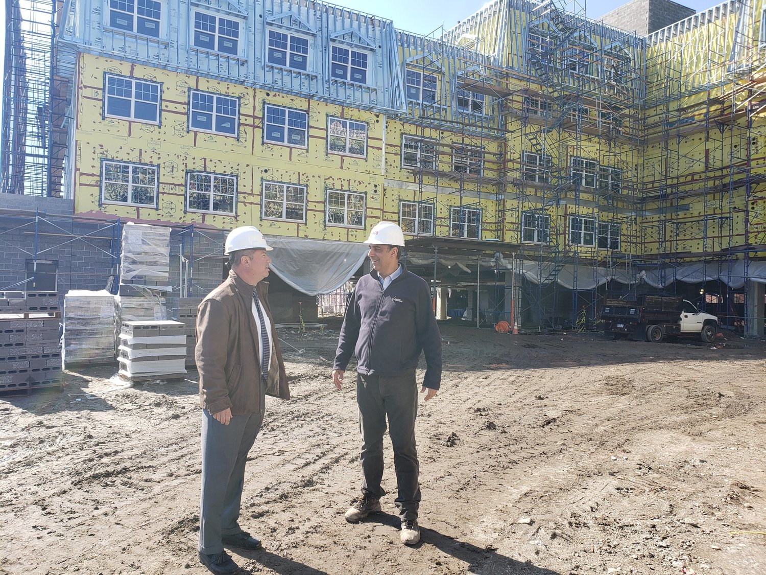 The Freeport Housing Authority's executive director, John Hrvatin, left, chatted with Jobco's project manager, Spiros Triantafyllou, about the progress on the new Moxey Rigby.