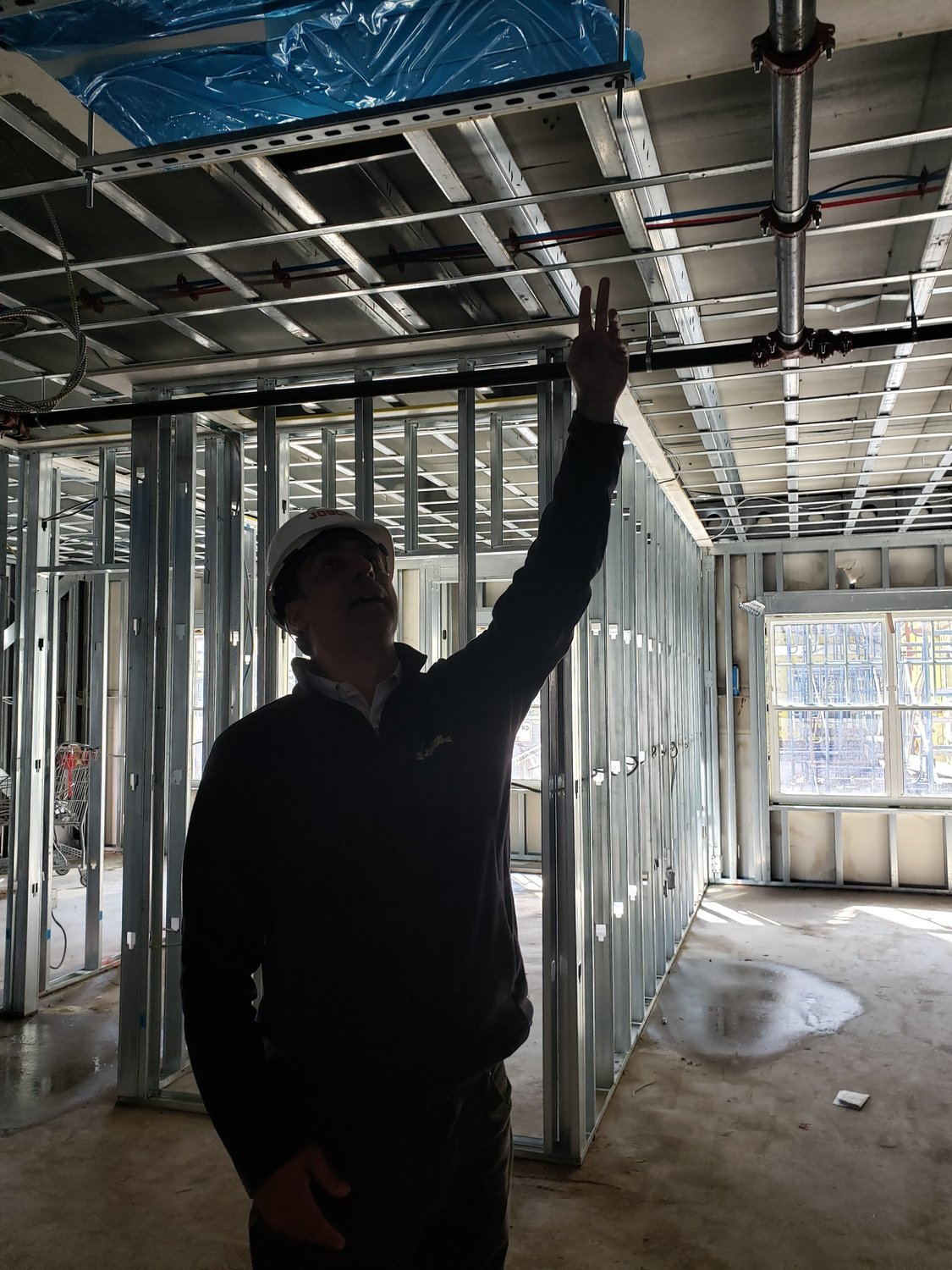 Jobco's project manager, Spiros Triantafyllou, pointed at the central heating and air conditioning in one of the apartments under construction at the new Moxie Rigby in Freeport.