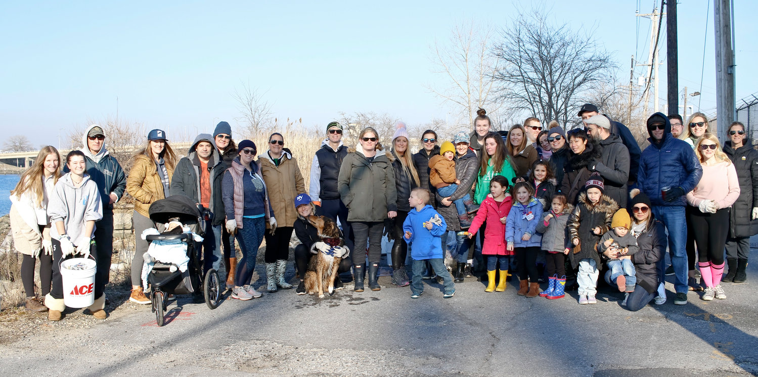 Volunteers with the Surfrider Foundation Central Long Island chapter cleaned up the bay on Saturday.