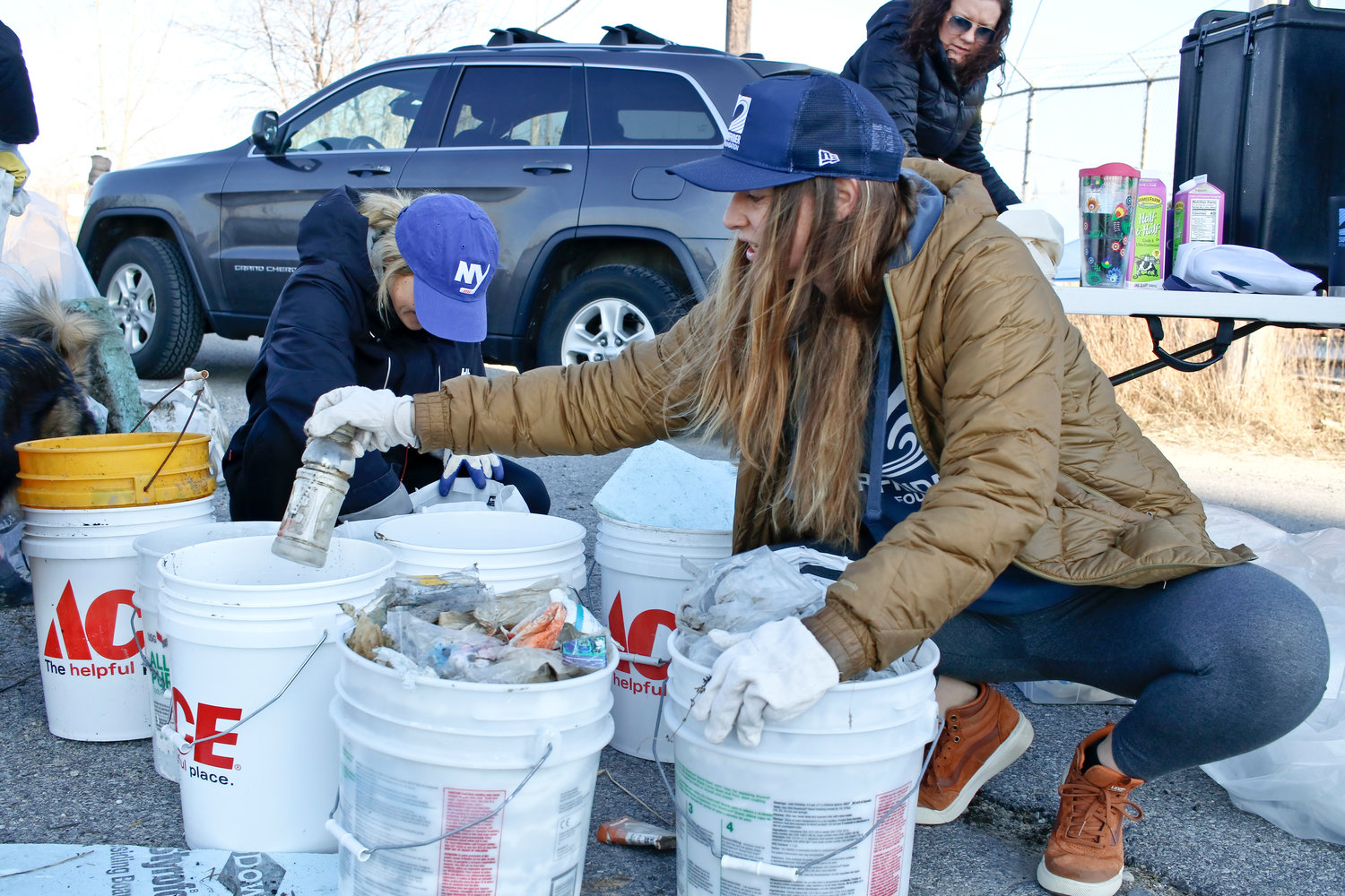 Amanda Moore, a member of the chapter's executive committee, sorted through trash and recyclables.