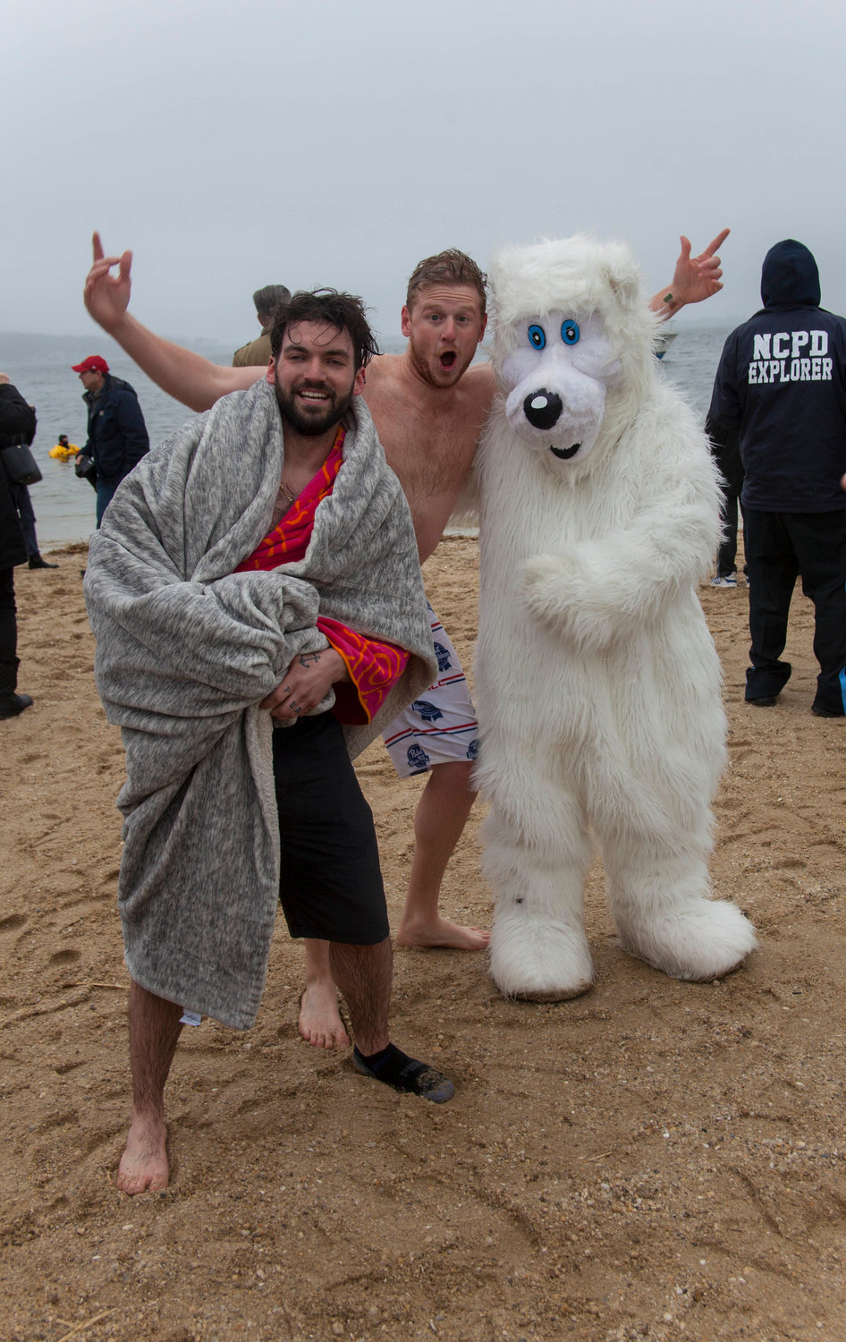 Travers Kalbero, left, and Alex Kushnir hung out with a mascot who appeared neither wet nor cold.