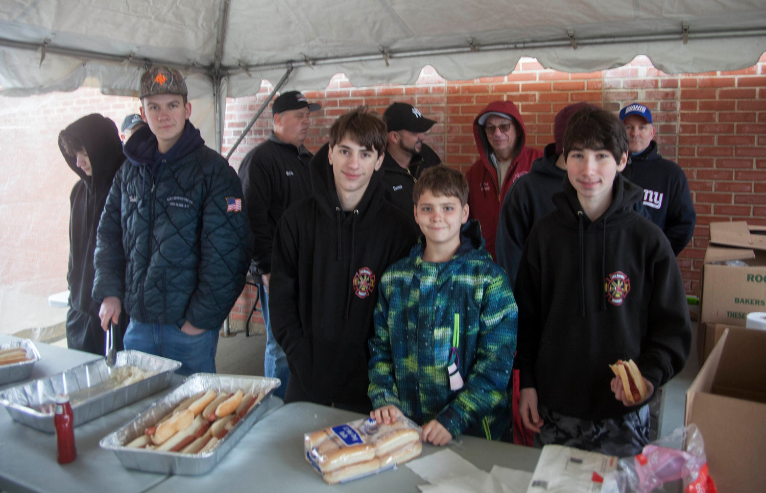 Connor Cronin, left, Jonathan Cox, Steve Wolfhurst and Paul Bott manned the food table.