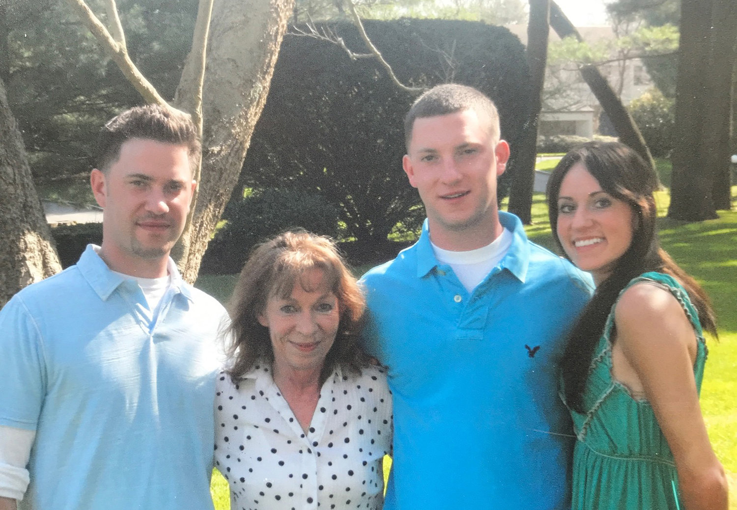 Greg Karris, far left, with his mother, Margaret Karris, his brother, Peter, and his sister, Cassandra Ottaviano.