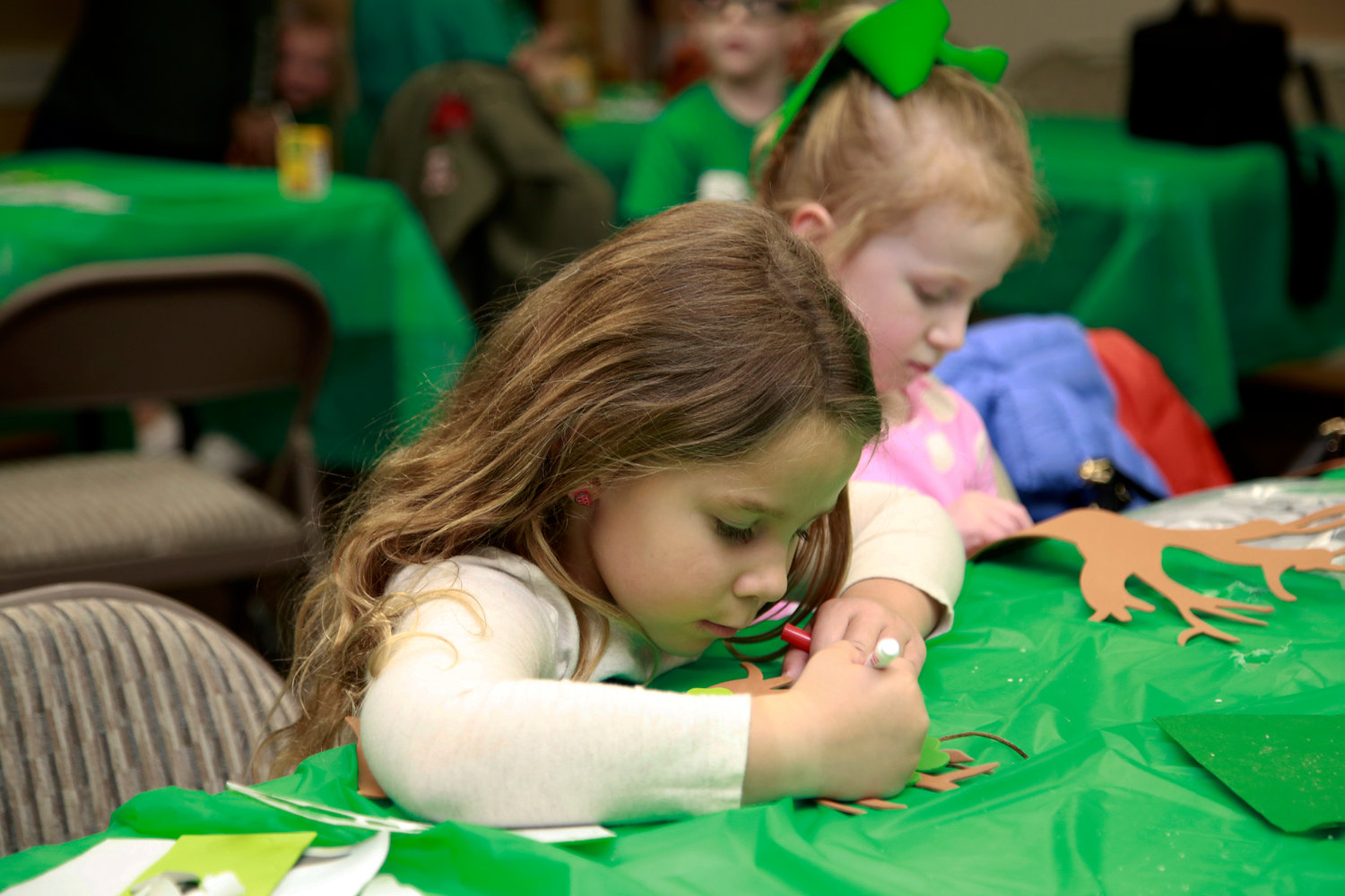 Audrey Touchard, 5, left, and Shannon Edwards, 4, worked on their crafts.