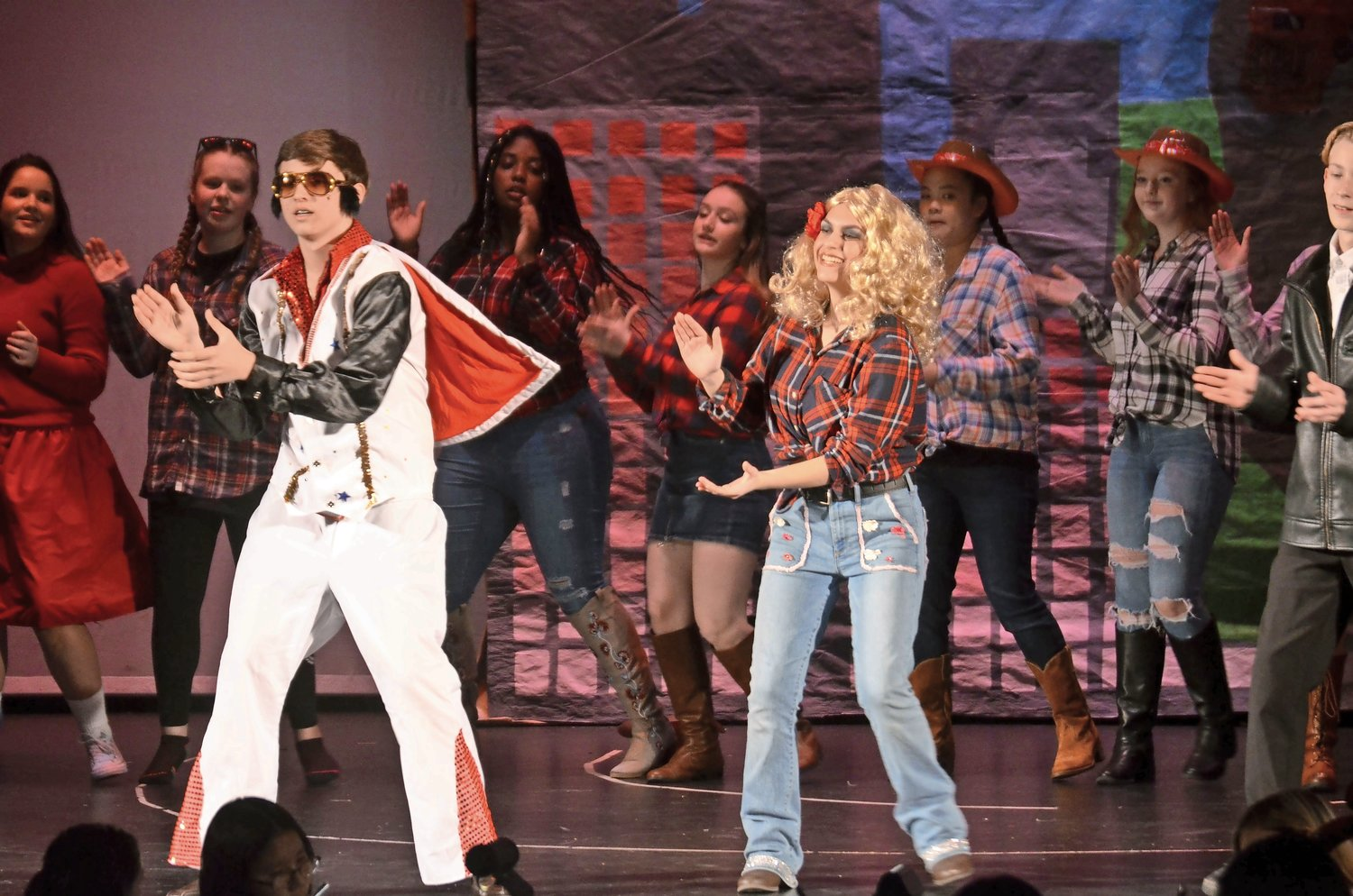 "Mike Kilgus played Elvis and Grace Wayer portayed Peyton Walker for the freshman class' entrance, ""Winner Takes it Y'all"" during the 83rd annual Rock Rivalry on March 15."