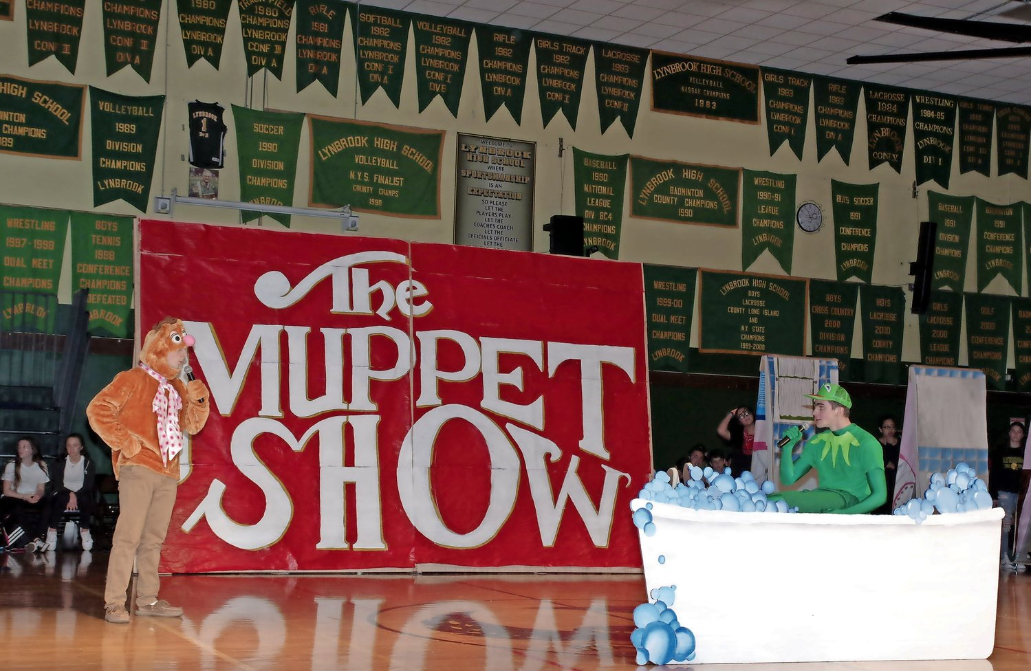 "Daniel Schneider, left, played Fozzie Bear and Richie Wiate was Kermit in the senior's performance of ""The Muppet Show."""