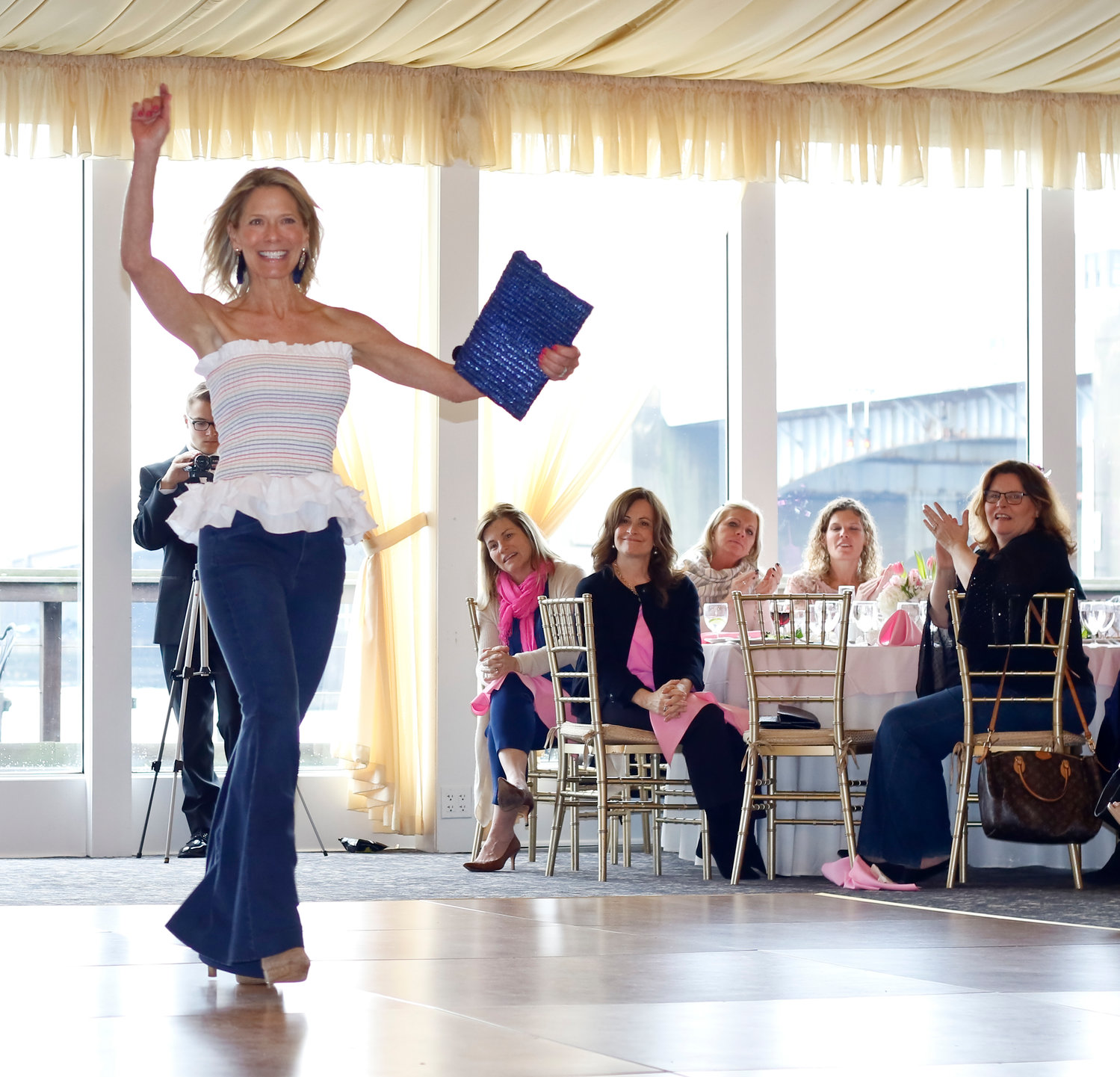 Meri Lupo modeled a rainbow peplum with Just Float on Flare jeans at the Rockville Centre Breast Cancer Coalition's second annual Fashion Show on March 10.
