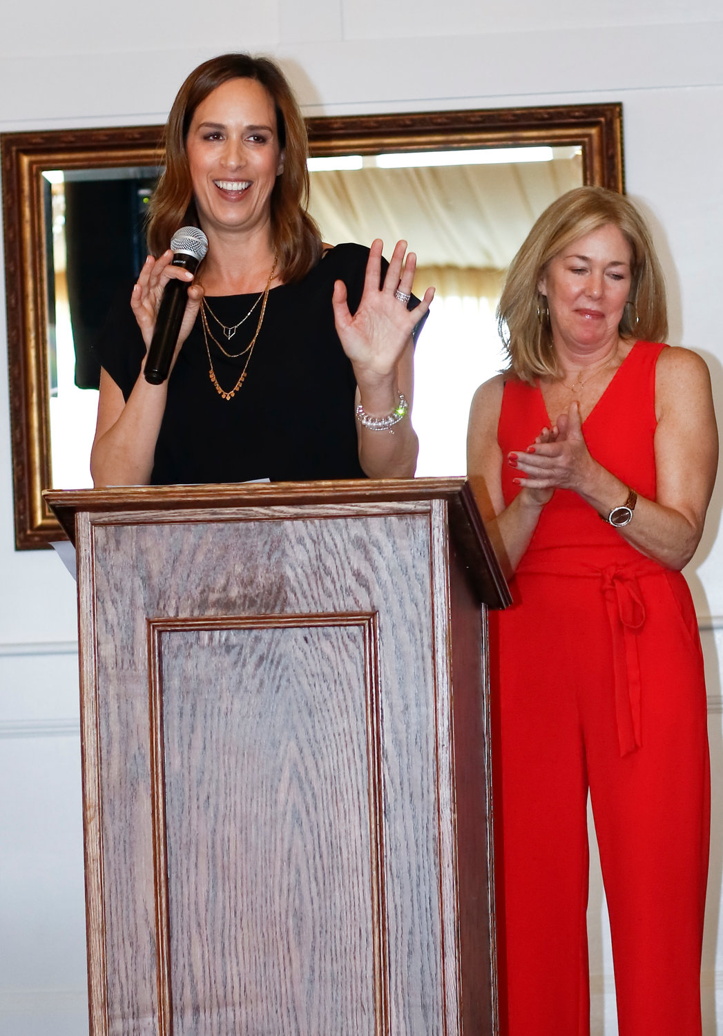 Erin O'Sullivan, left, alongside Peg McDonald, spoke to the crowd about the Coalition's recent accomplishments.