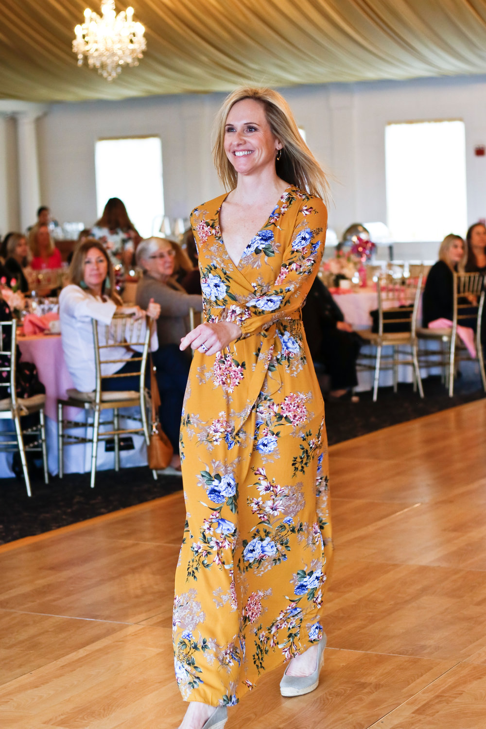 Laura Altman modeled a floral-print dress by Luxe.