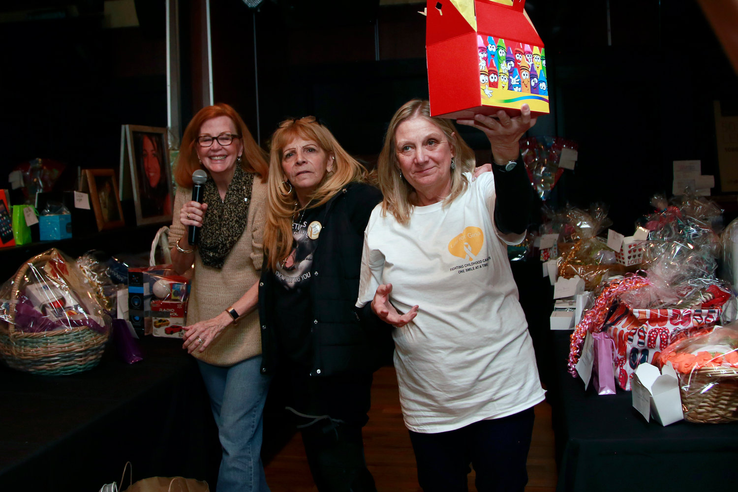 Mimi Calvo, left, Marie Giallombardo, Gina's mother, and Sue Hill announced raffle winners.