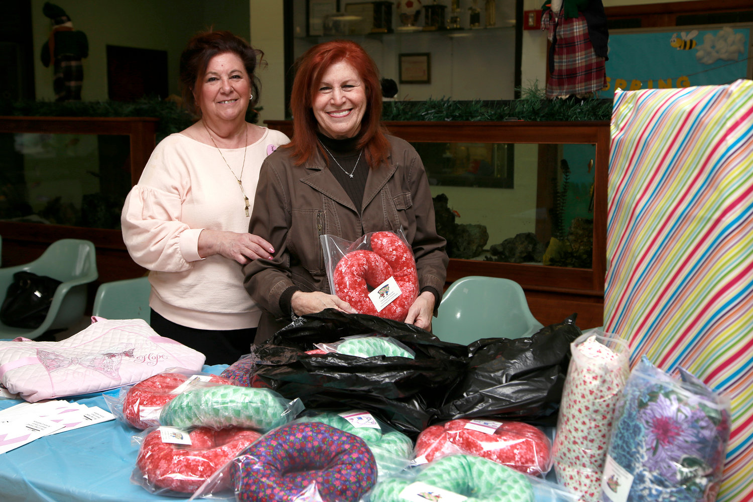 Geri Barish, of Hewlett House, was grateful for the neck pillows made by the Rockville Centre Homemakers, represented by Karen Alterson, the group's co-president.