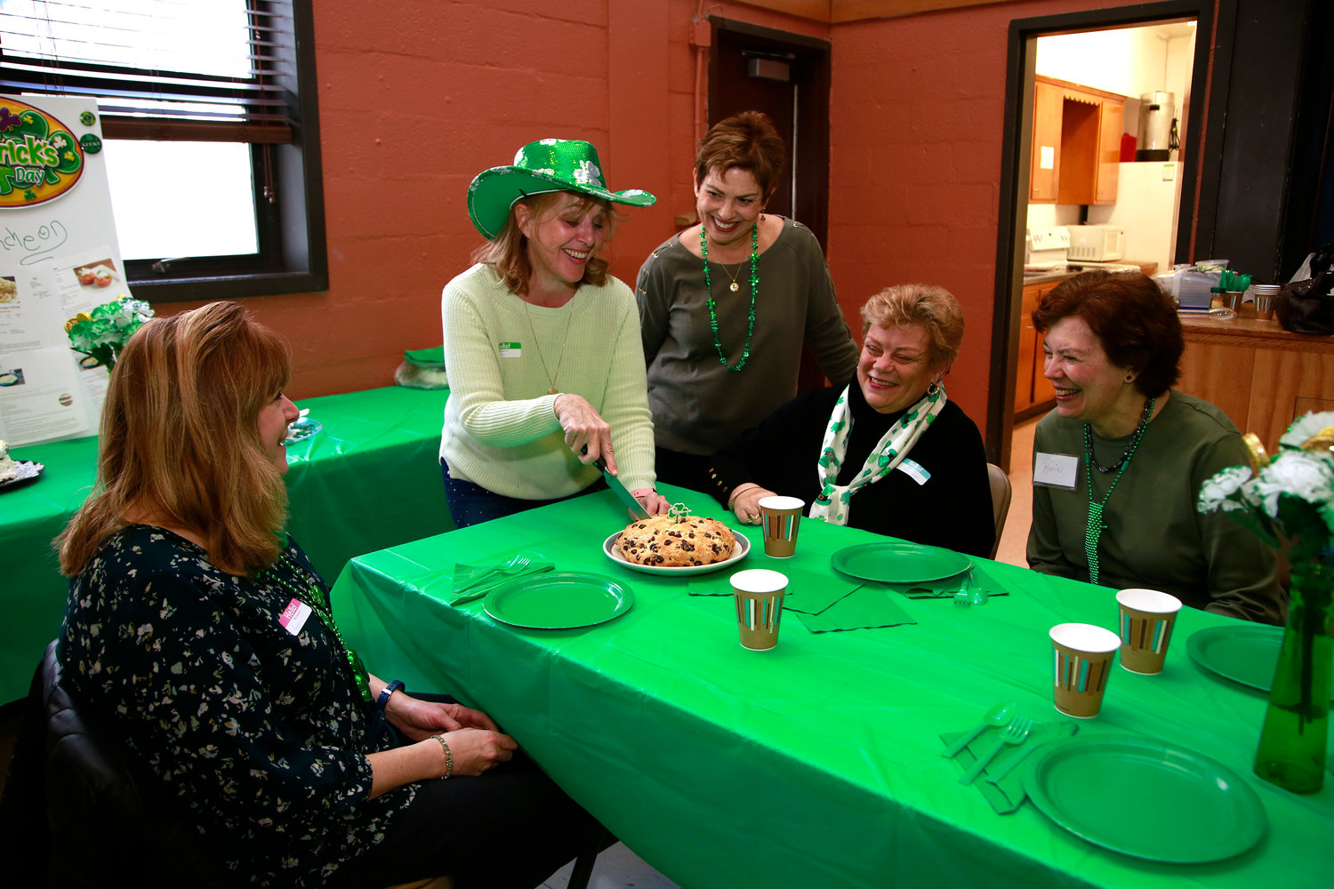 Marilyn Jurgensen, Terry Schmitt, Pat Gagliardi, Barbara Lehman and Karin Levy excitedly dug into homemade Irish Soda Bread.