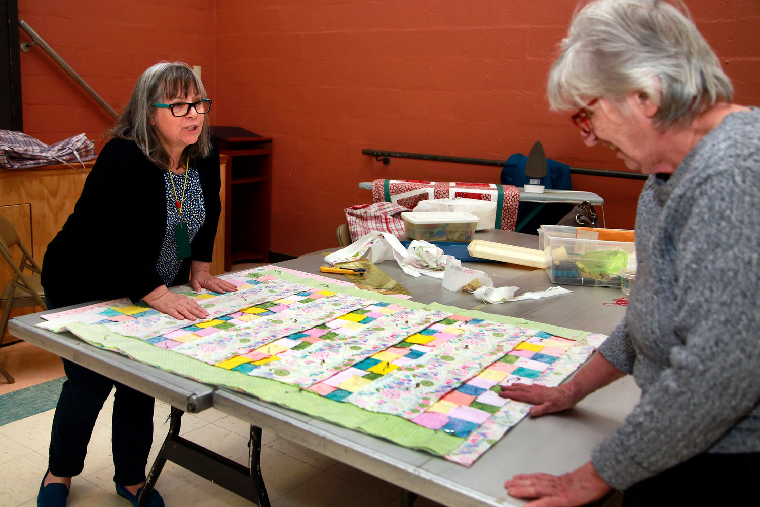 Kim Chiusano and Paula Mazzola worked on a quilt last week.