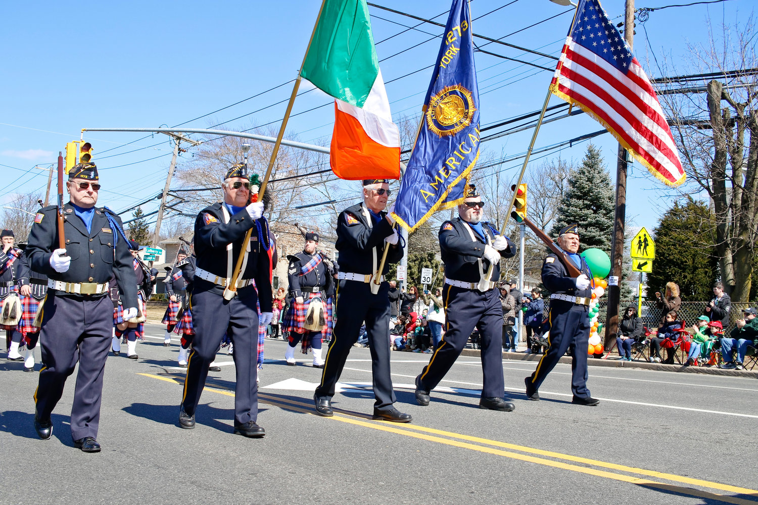 Wantagh American Legion members, from left, Tom Humphrey, Jim Leys, Don Katz, Mark Grieker and Fred Maffeo led the first annual St. Patrick's Day parade down Wantagh Ave.